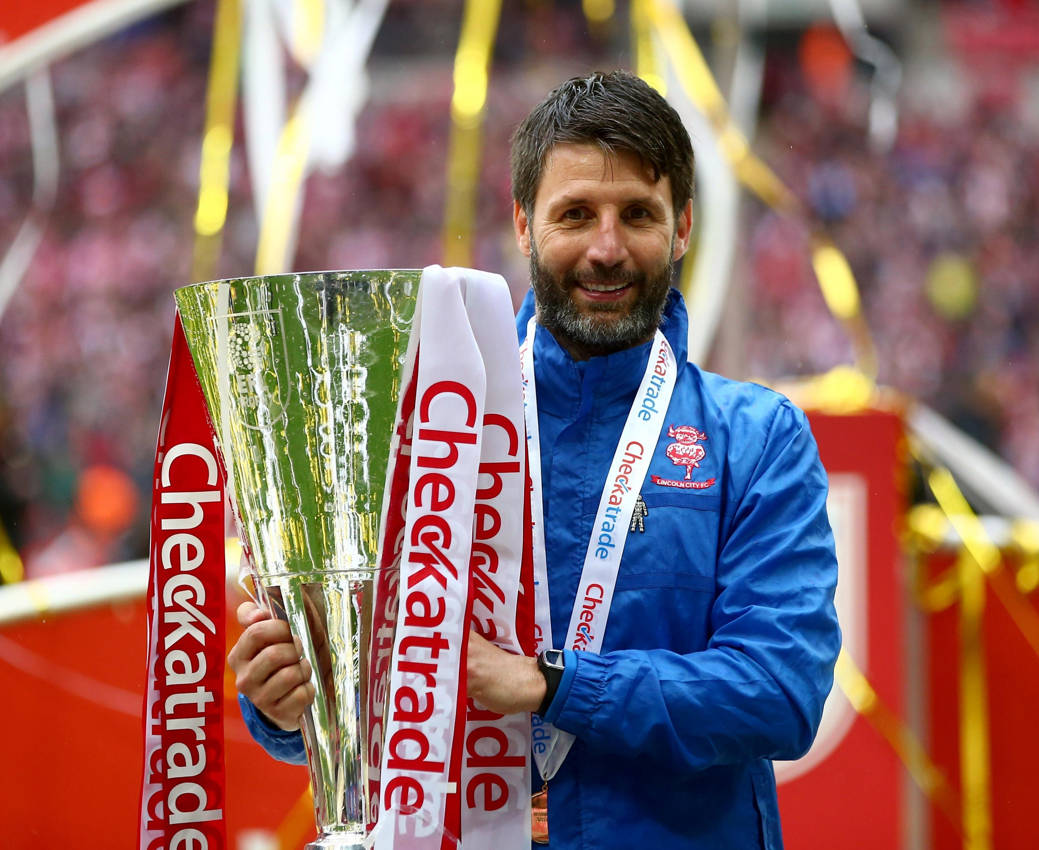 Delighted Imps manager Danny Cowley with the trophy