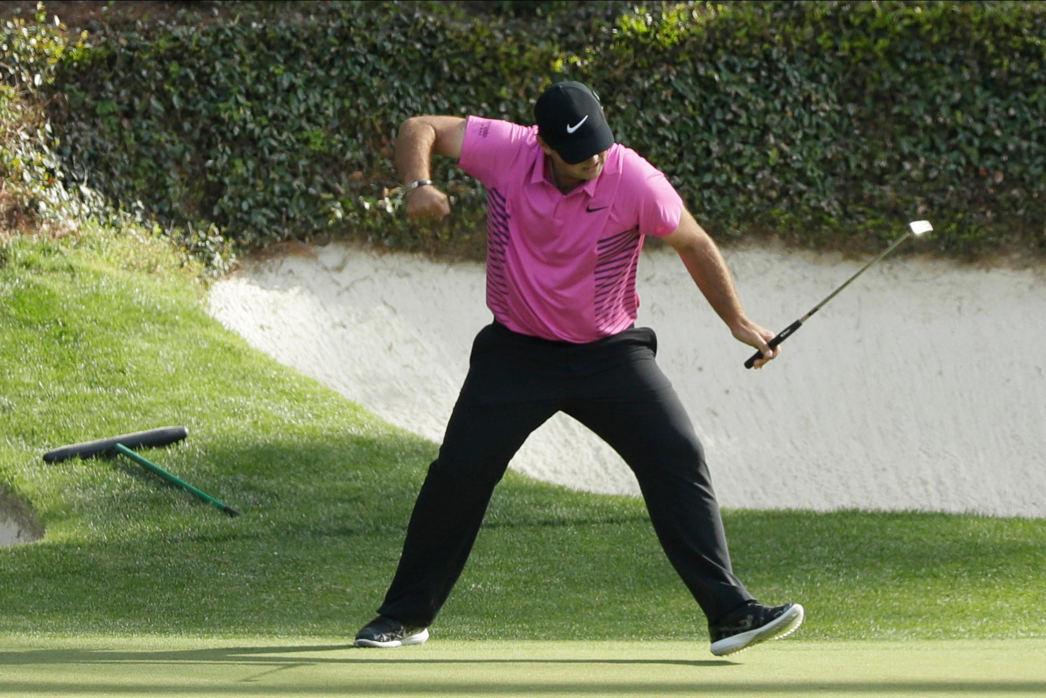 Patrick Reed saw off a surging Rickie Fowler to win the green jacket