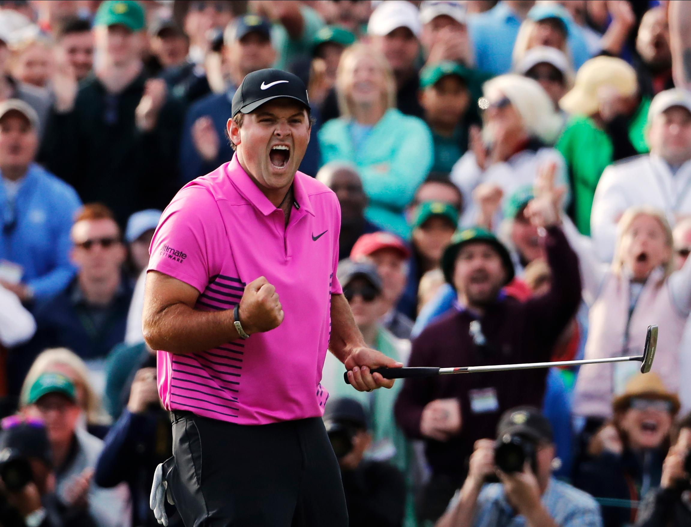 Patrick Reed celebrates winning the Masters after holding off challenges from Jordan Spieth and Rickie Fowler