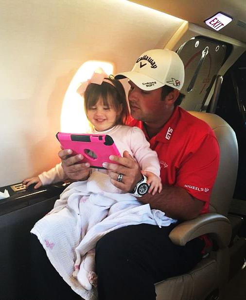 Reed spends time with one of his two daughters and their iPad