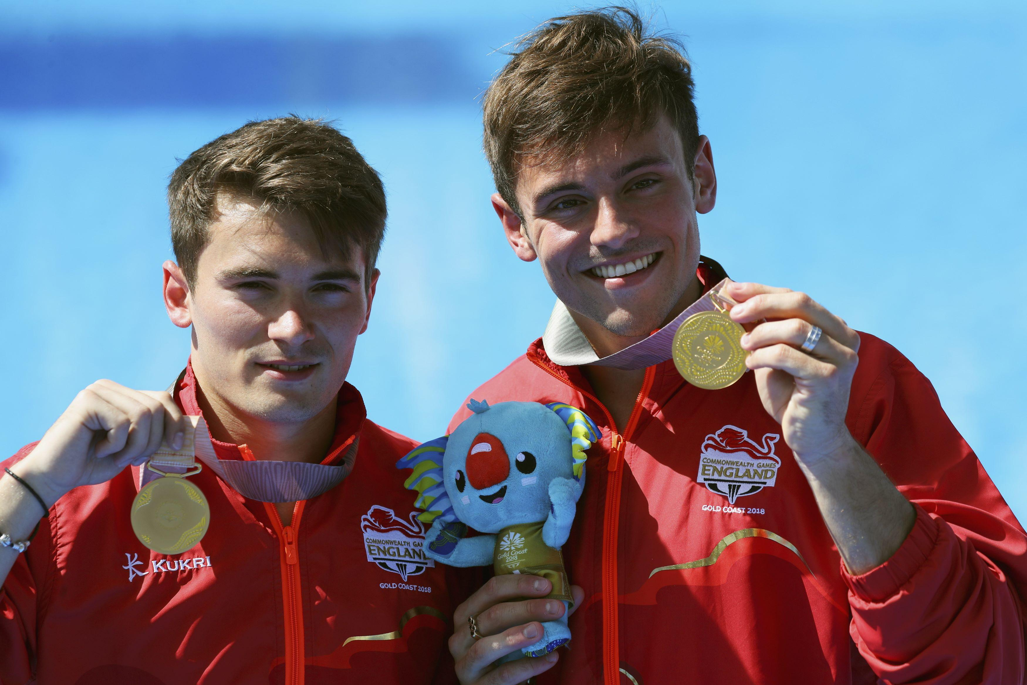 The pair brandish medals for the Men's Synchronised 10m Platform event