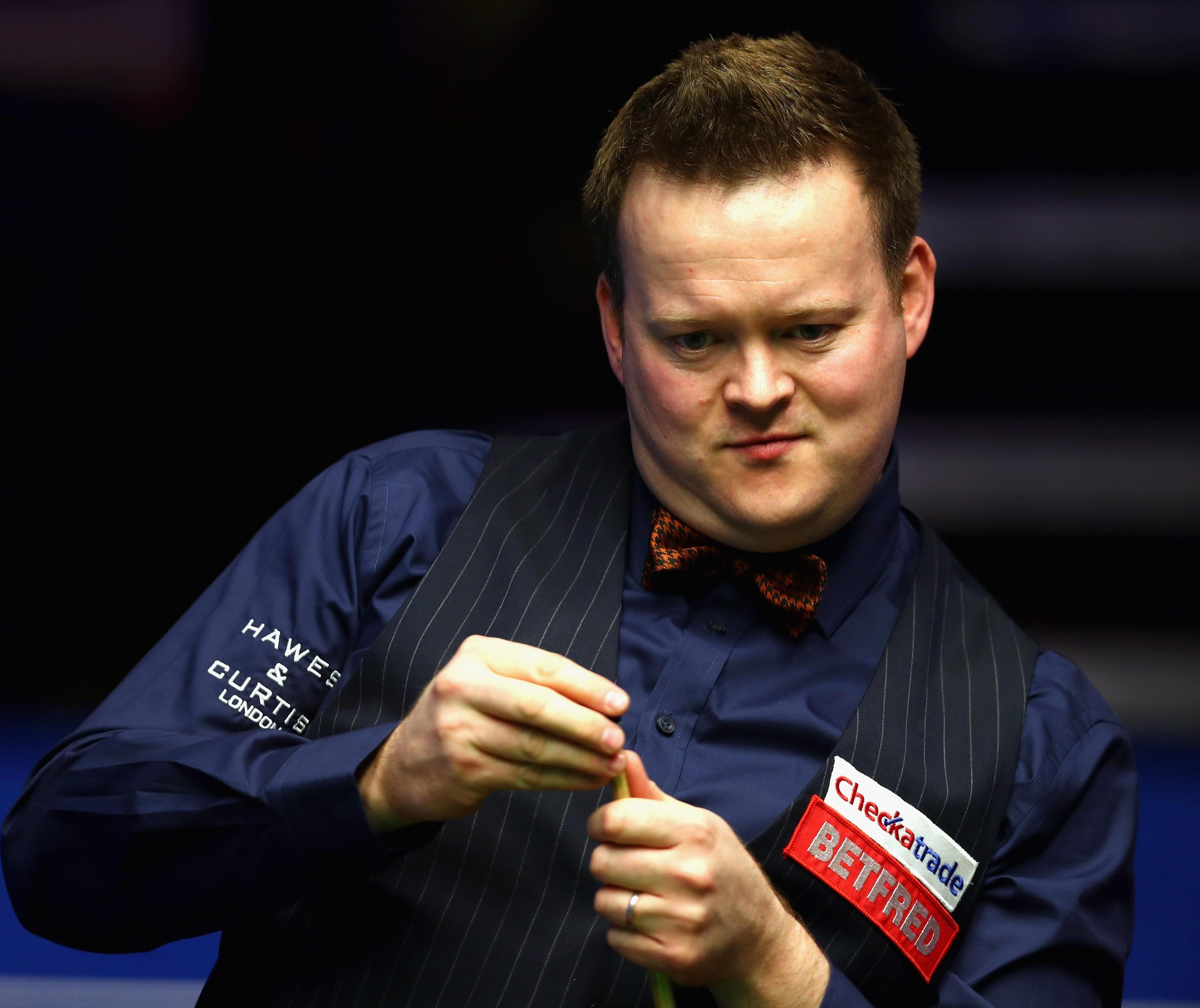 Shaun Murphy keeps his eyes on the ball - while some fans elsewhere in the arena struggled to even keep theirs open