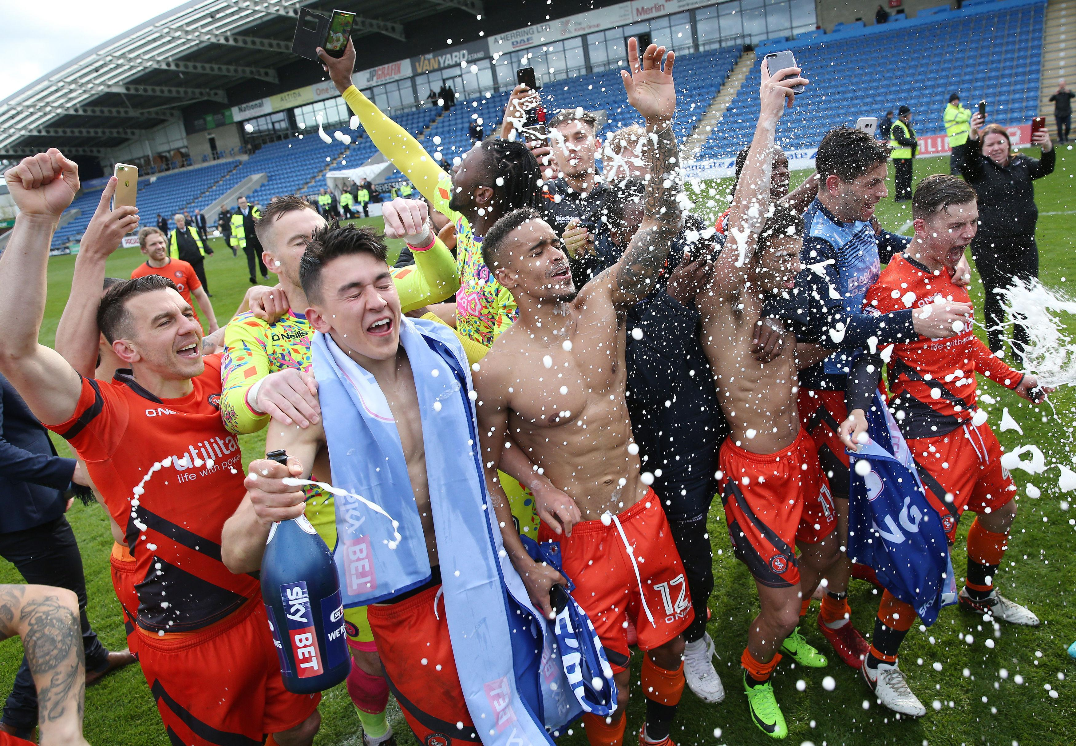 Wycombe Wanderers celebrate earning promotion to League One