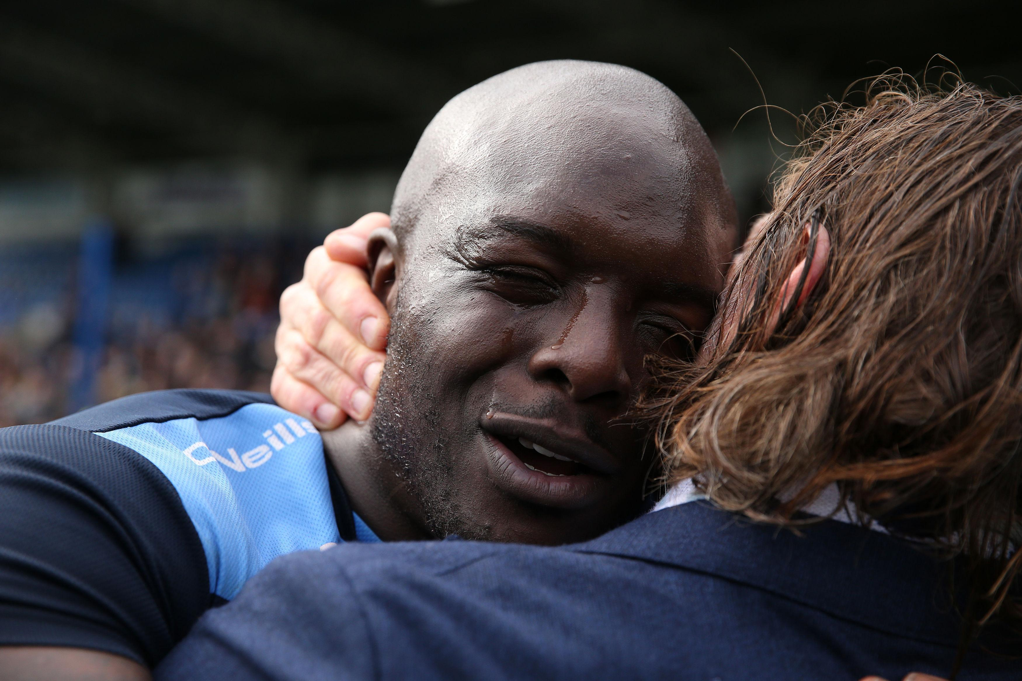 Adebayo Akinfenwa cries in joy after securing promotion with Wycombe