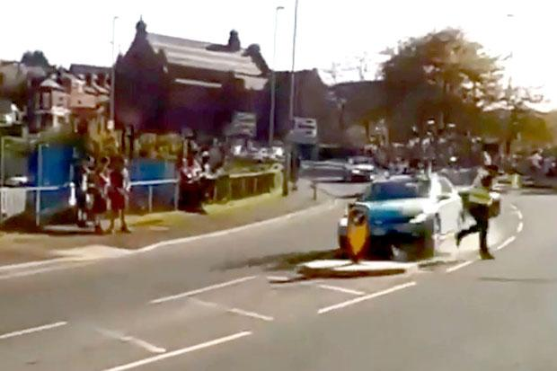 A Tour de Yorkshire volunteer narrowly dodges an out of control car