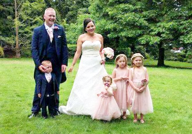 Aimee and Craig with their children, son Harloe, 2, Nualah, 1, Niabhy, 5 and Brogan-Lei, 7 on their wedding day