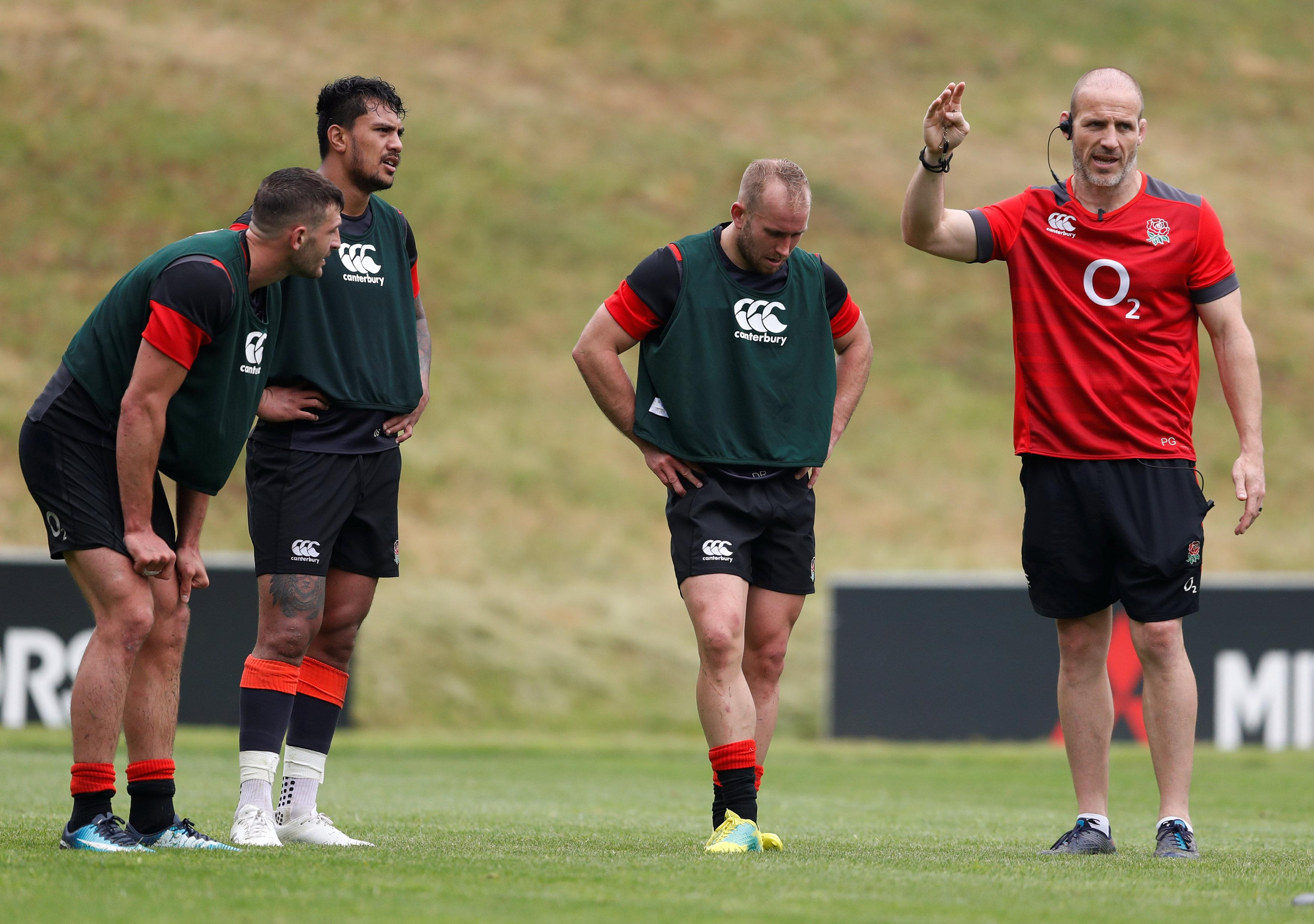 Former England defence coach Paul Gustard, right, quit England for Harlequins