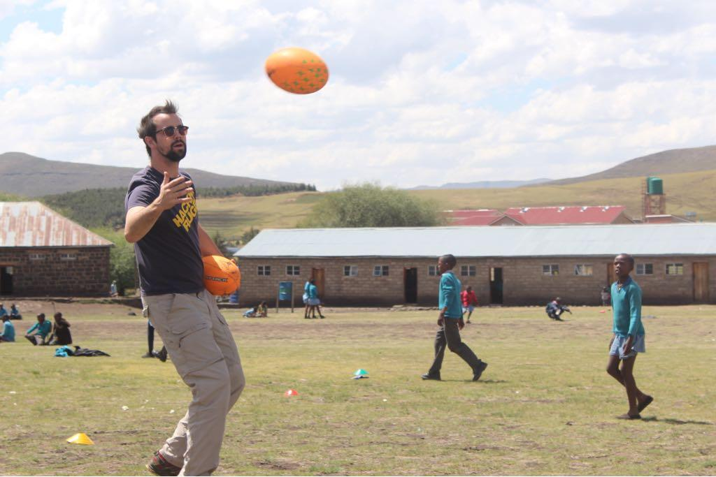 Hackney Rugby Club's Dan Aylward teaching kids how to play the game in Lesotho