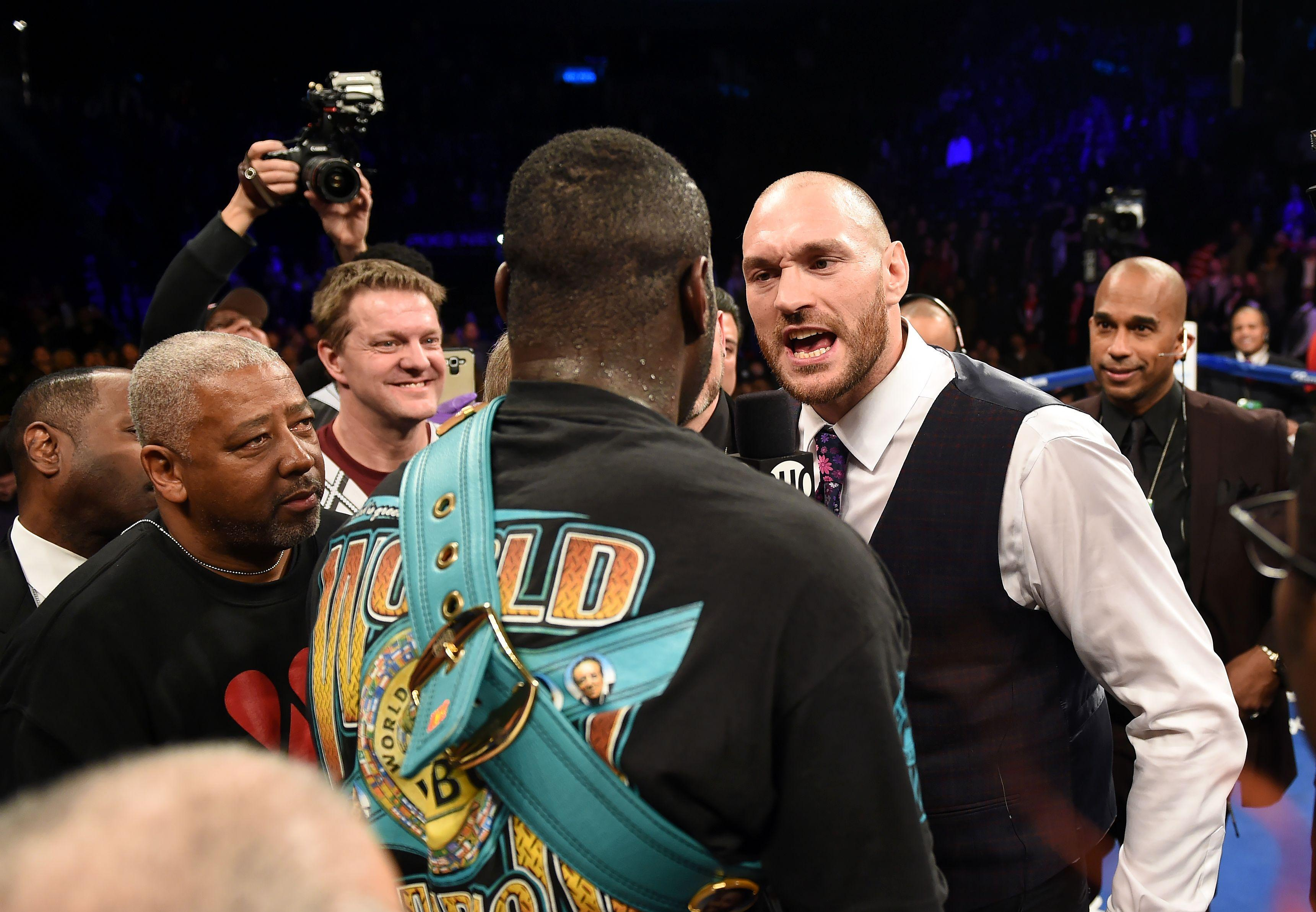 Tyson Fury confronts Deontay Wilder when the American defeated Artur Szpilka in January 2016