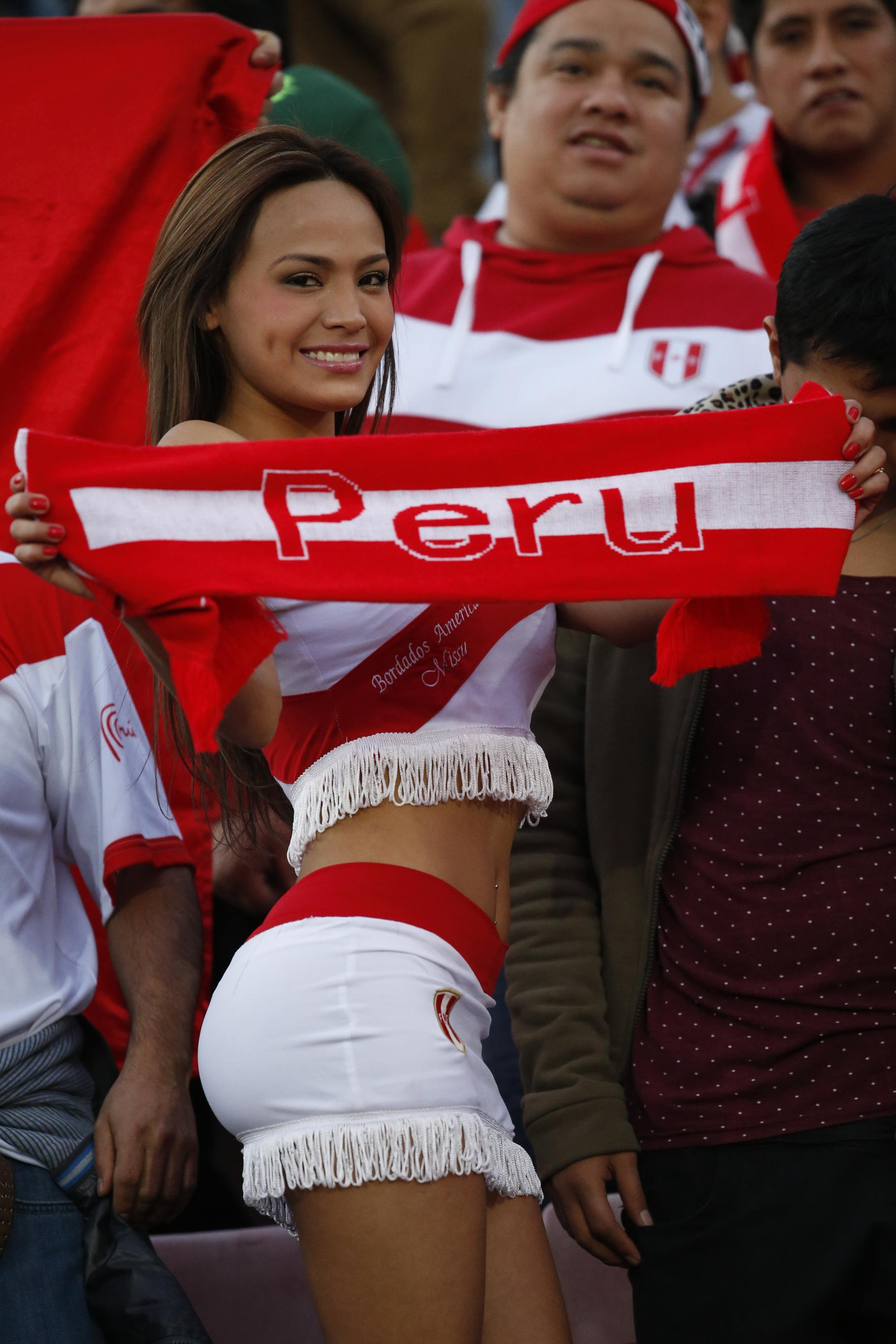 Scarf ace Nissu Caitu is a big hit in the stands as she cheers on her country, Peru