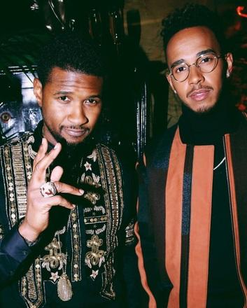 Hamilton poses with pop superstar Usher