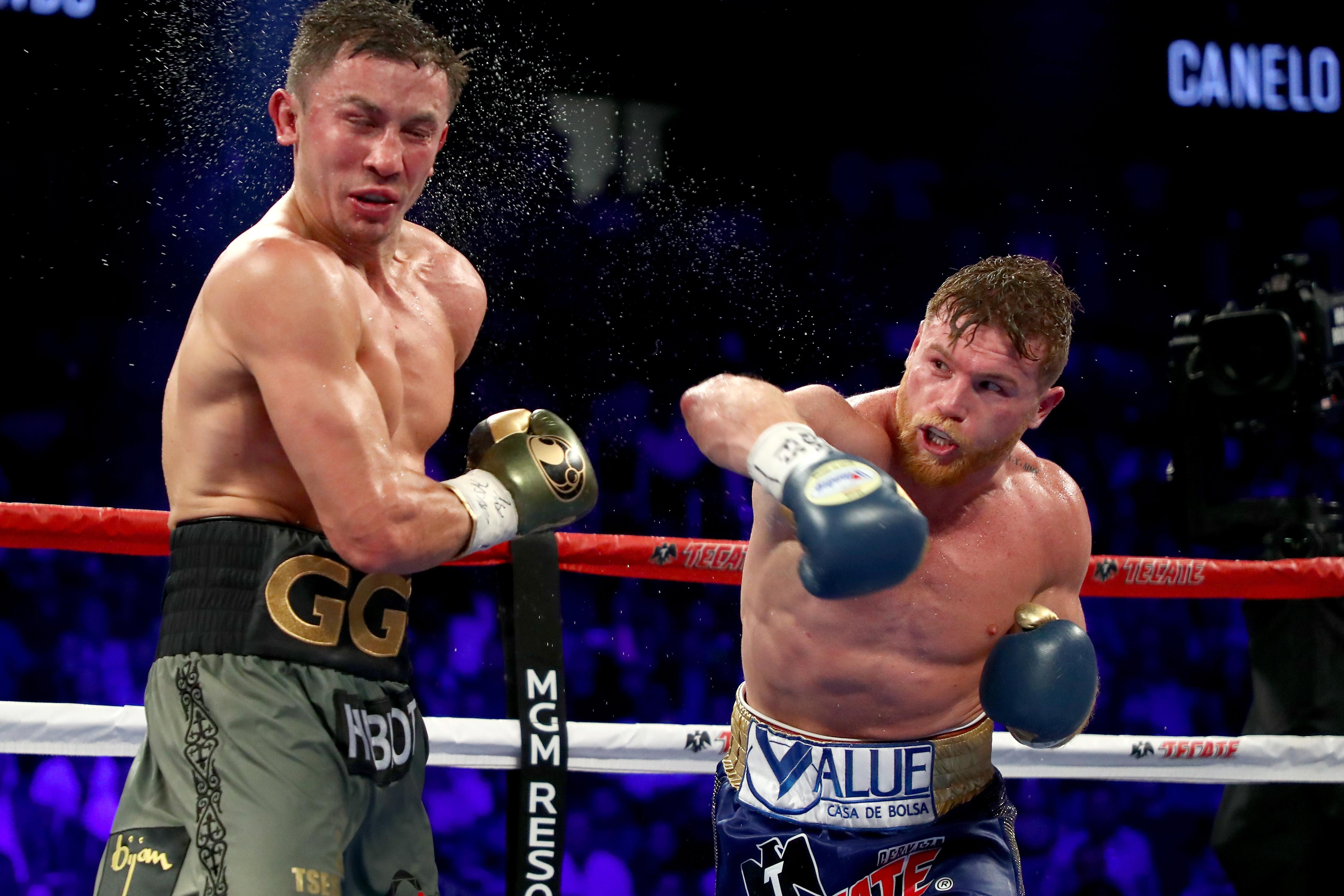 Saul Alvarez lands a punch on Gennady Golovkin in the first fight