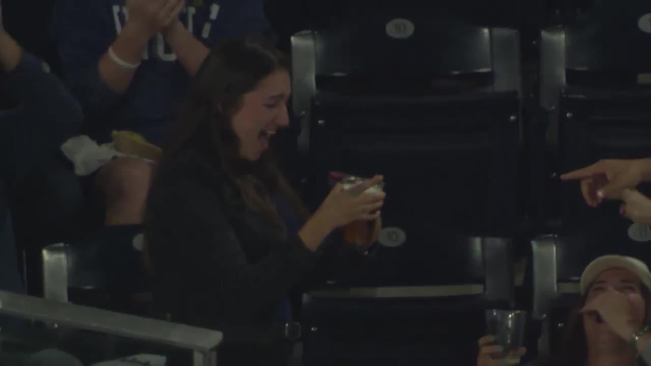 DiMarco was over the moon after the ball landed in her pint following a home run