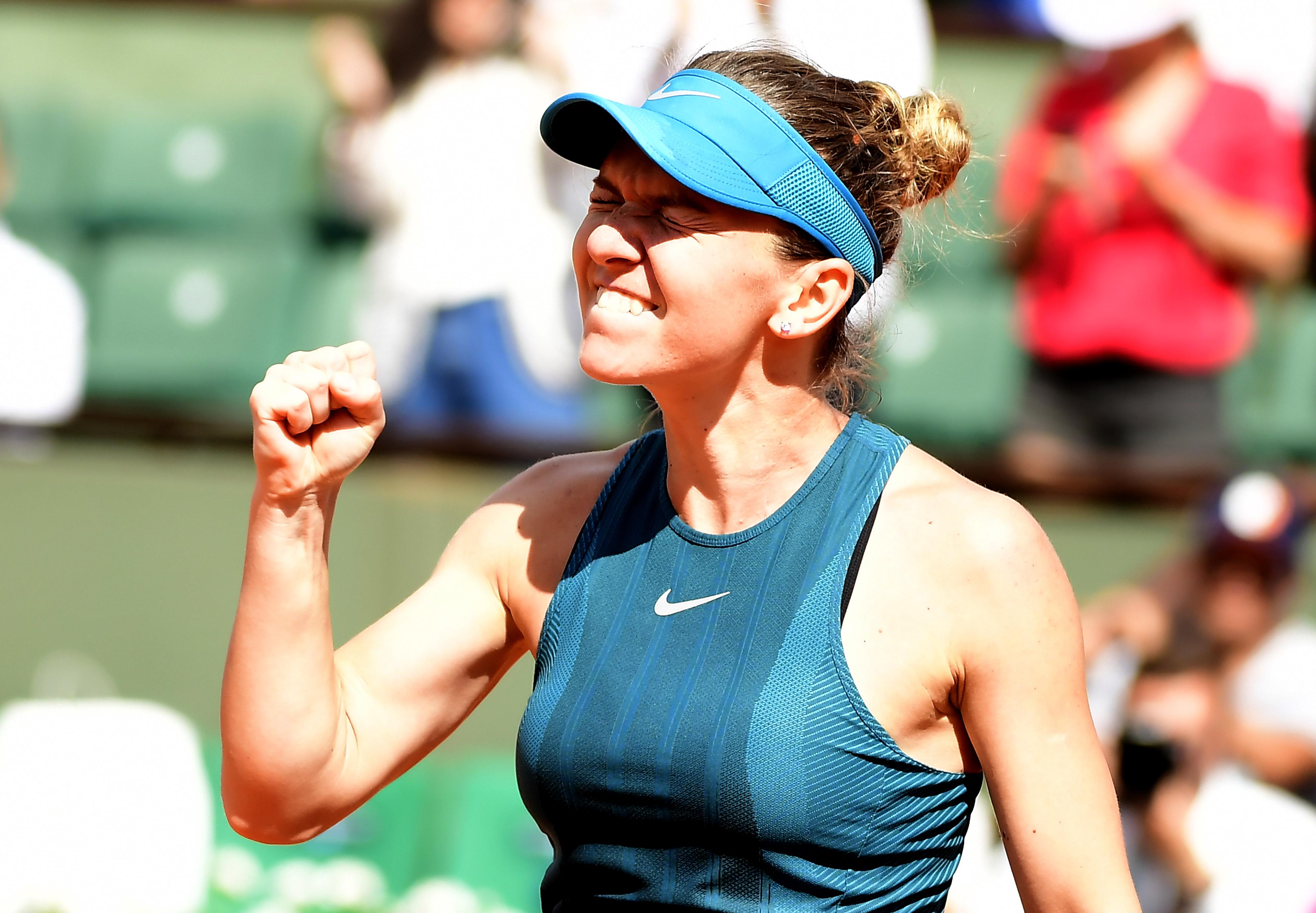 Simona Halep celebrates after destroying Garbine Muguruza in the French Open semi-final