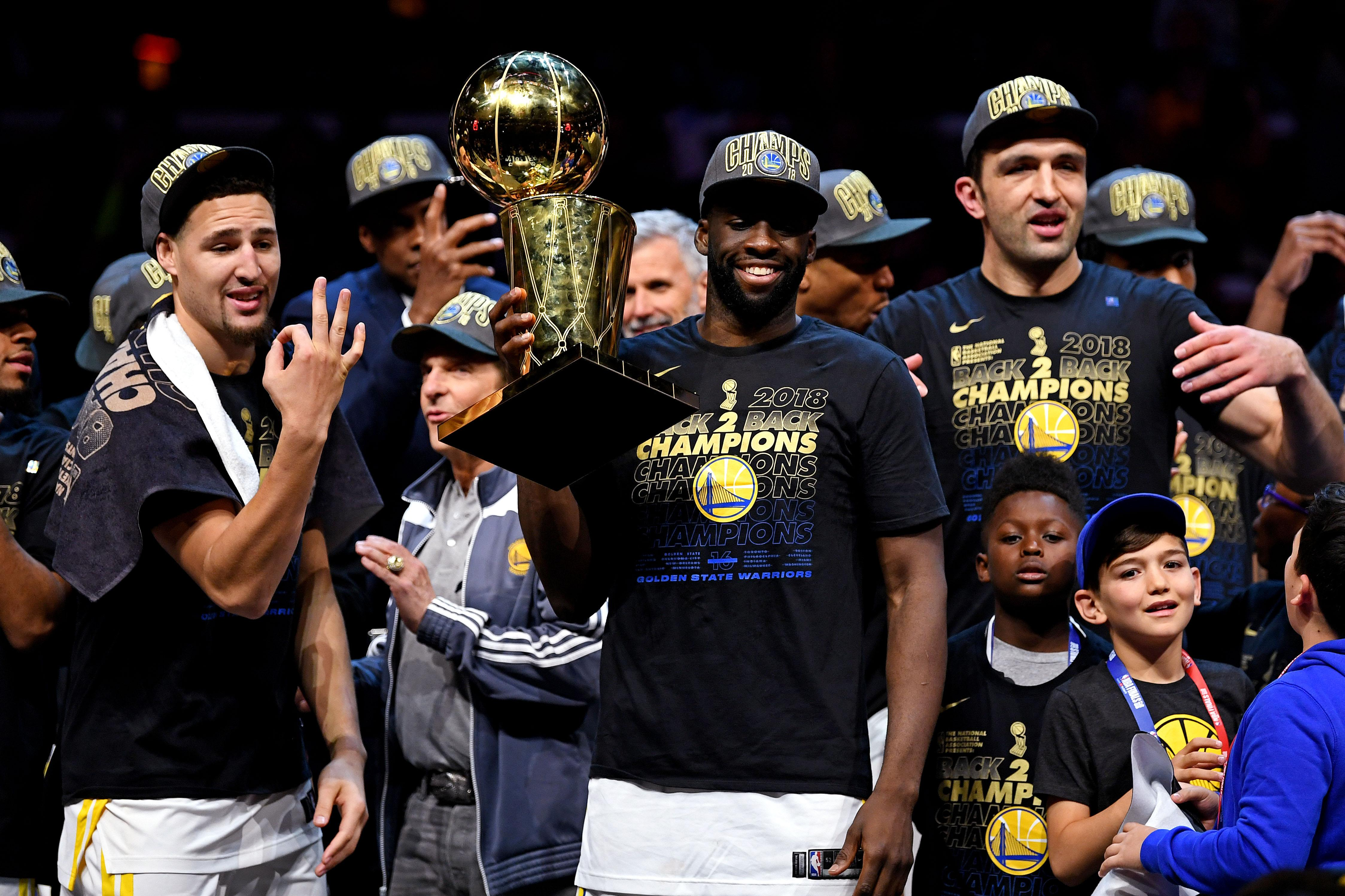 The Golden State Warriors celebrate after winning the NBA championship with a wipeout of Cleveland Cavaliers