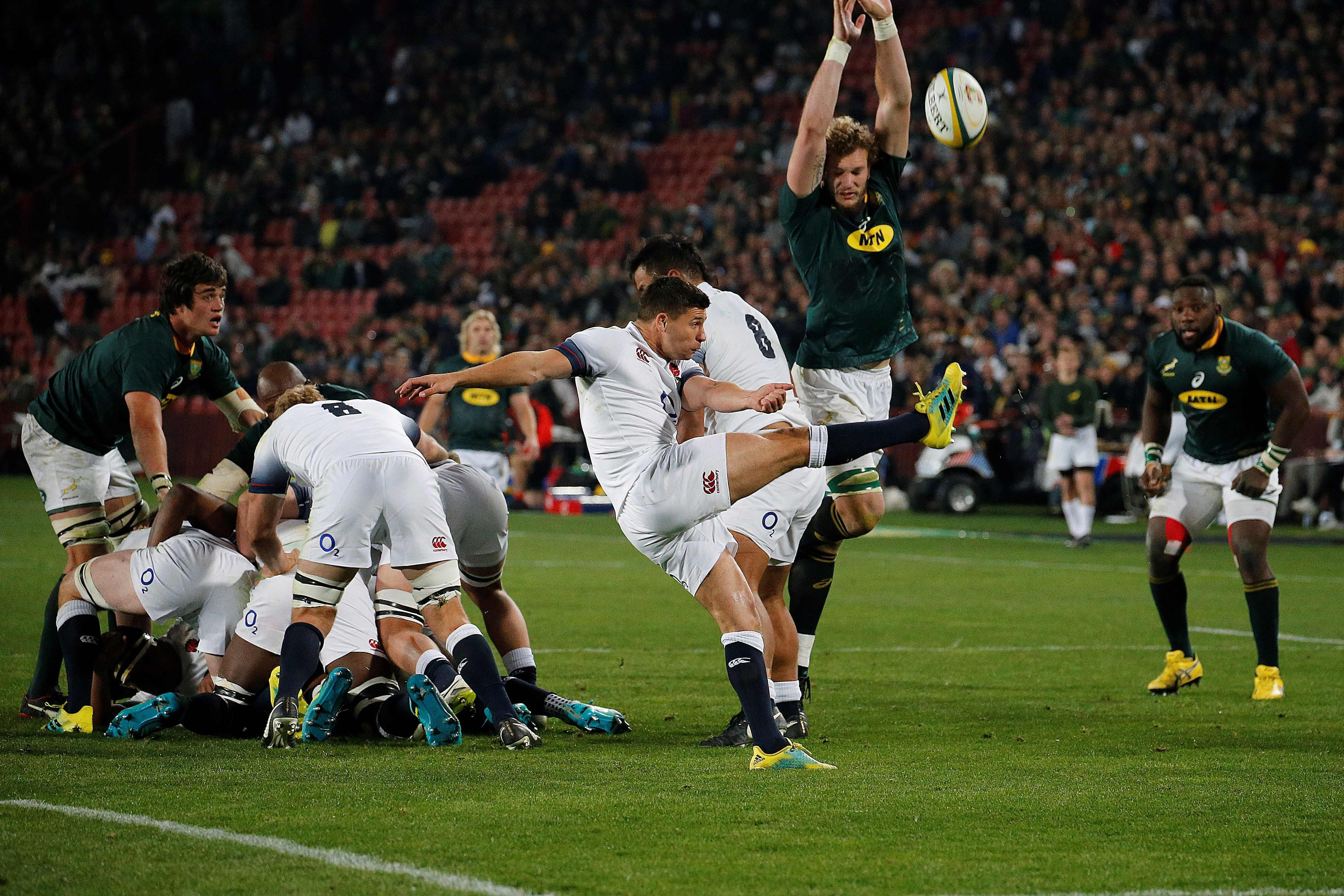 Fly-half George Ford kicks the ball away from danger during the first test match between the two nations