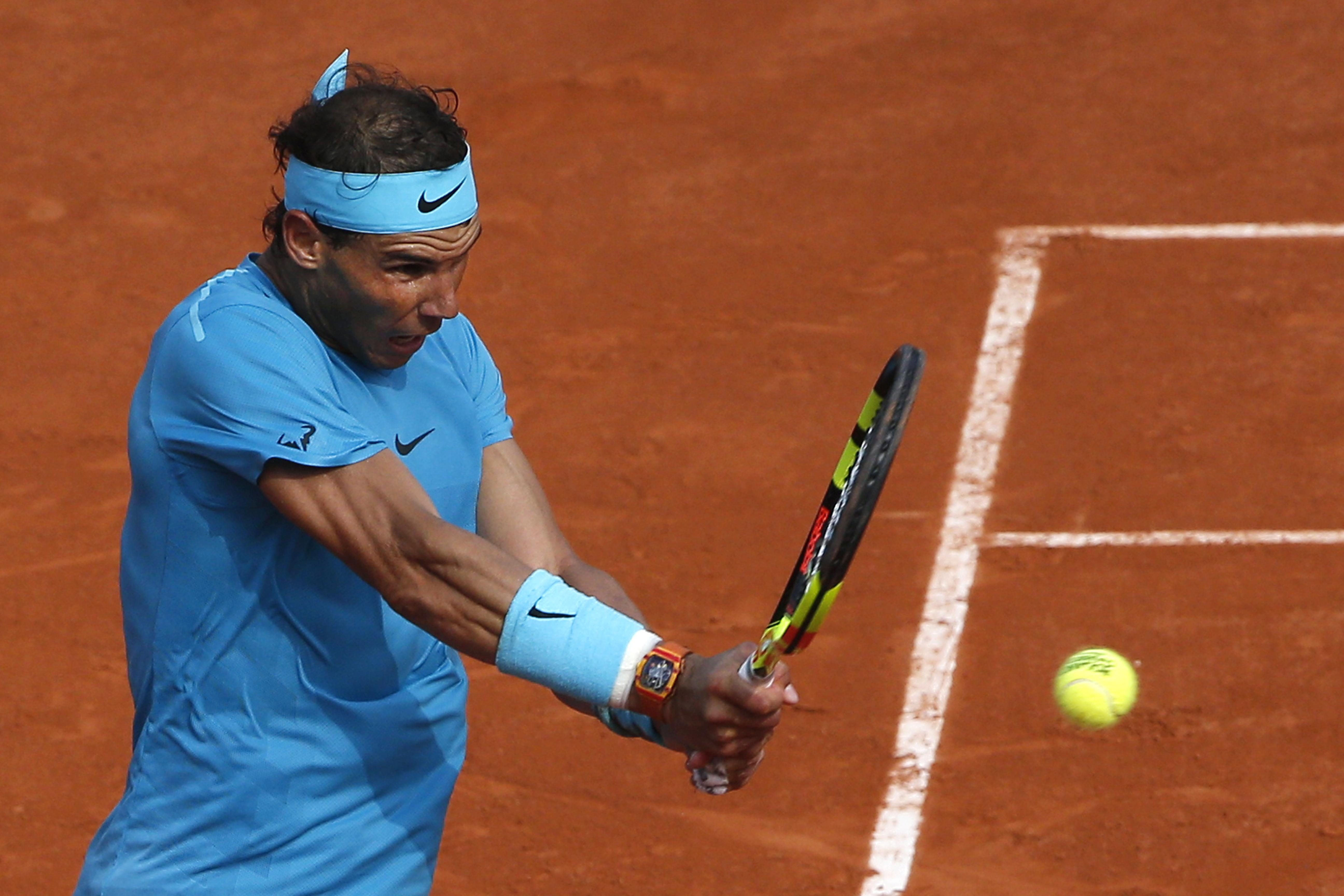 Nadal's cramp knocked him for a short time, but he came back to his best to ensure he lifted the Roland Garros trophy