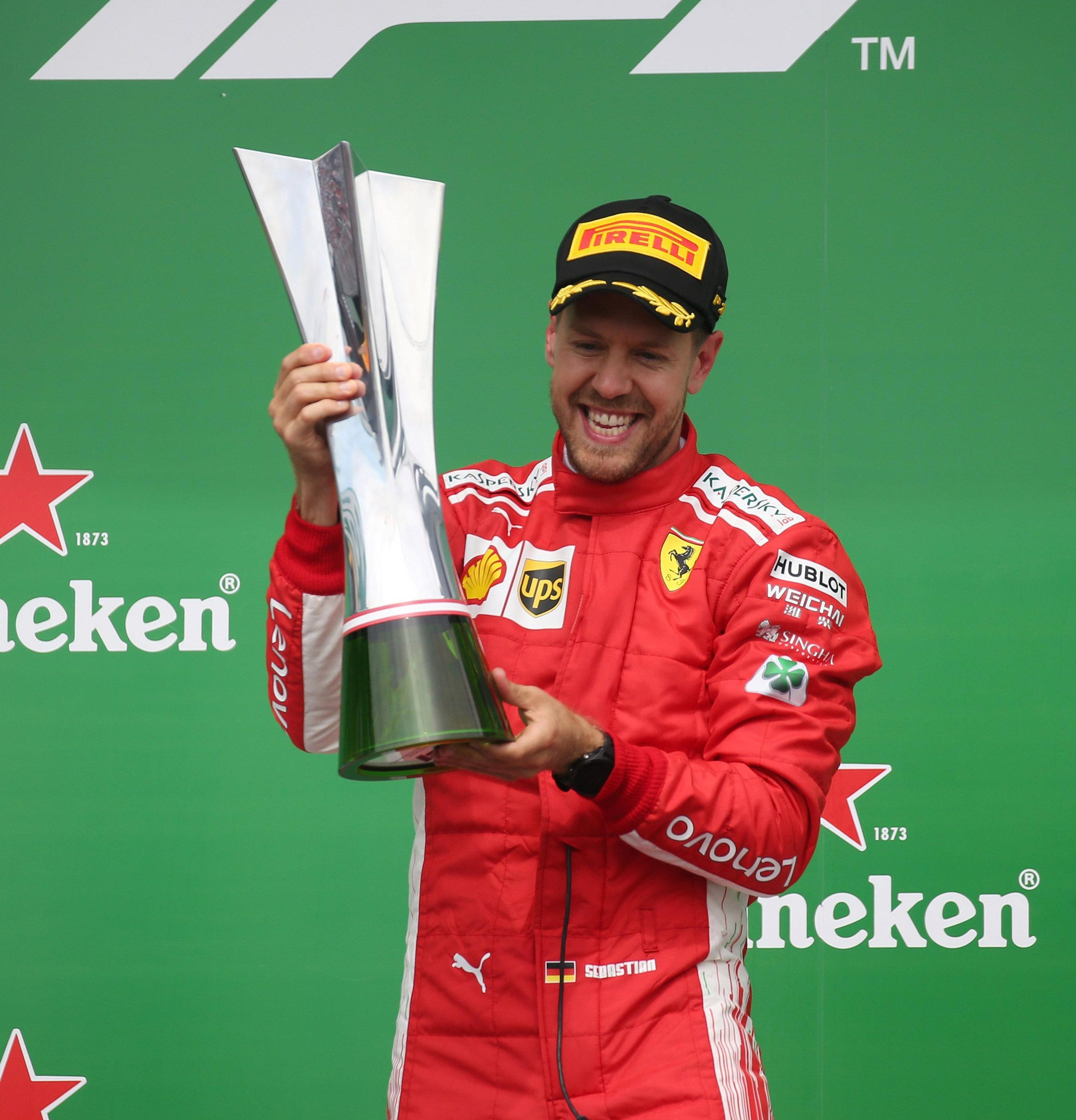 Seb Vettel overtakes Lewis Hamilton at the top of the drivers' championship