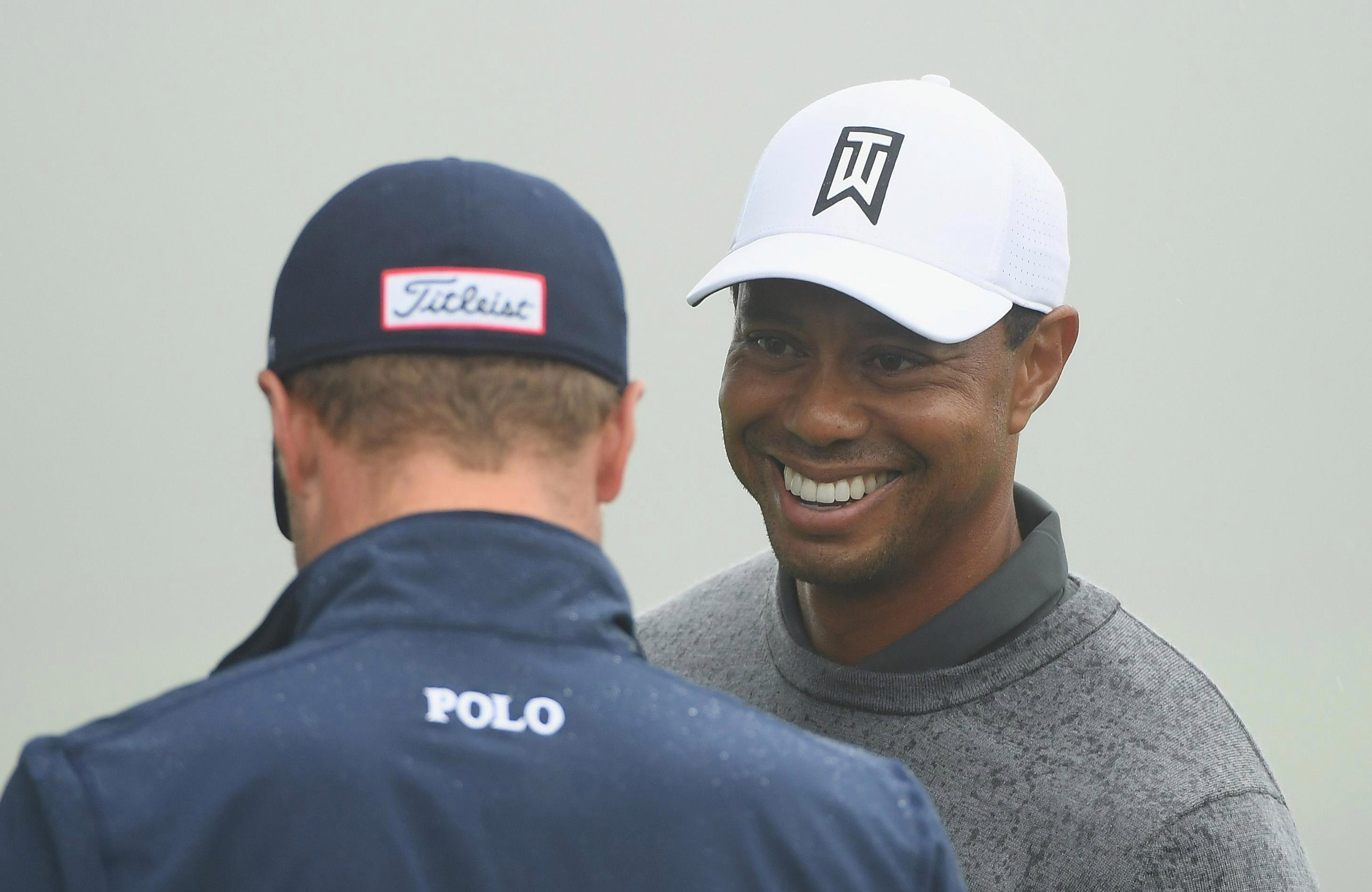 Tiger Woods is all smiles ahead of the first round