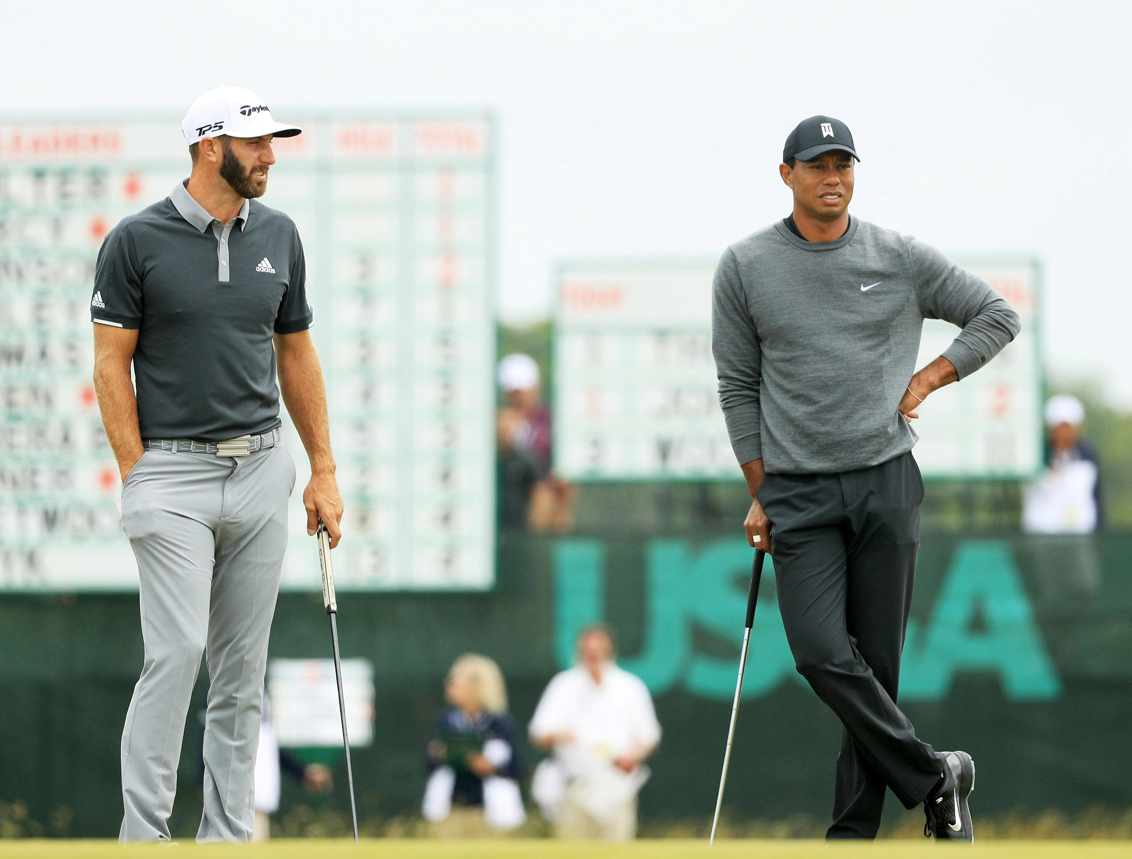 Tiger Woods and his playing partner Dustin Johnson couldn't have had much different luck out there on the course