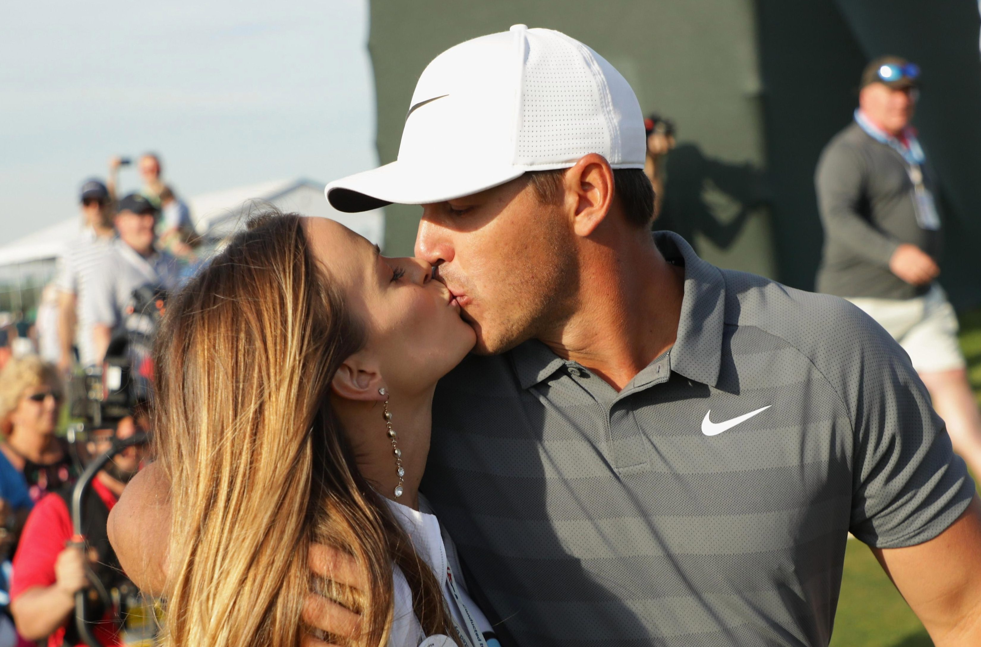 Brooks Koepka celebrates his victory with a kiss from girlfriend Jena Sims