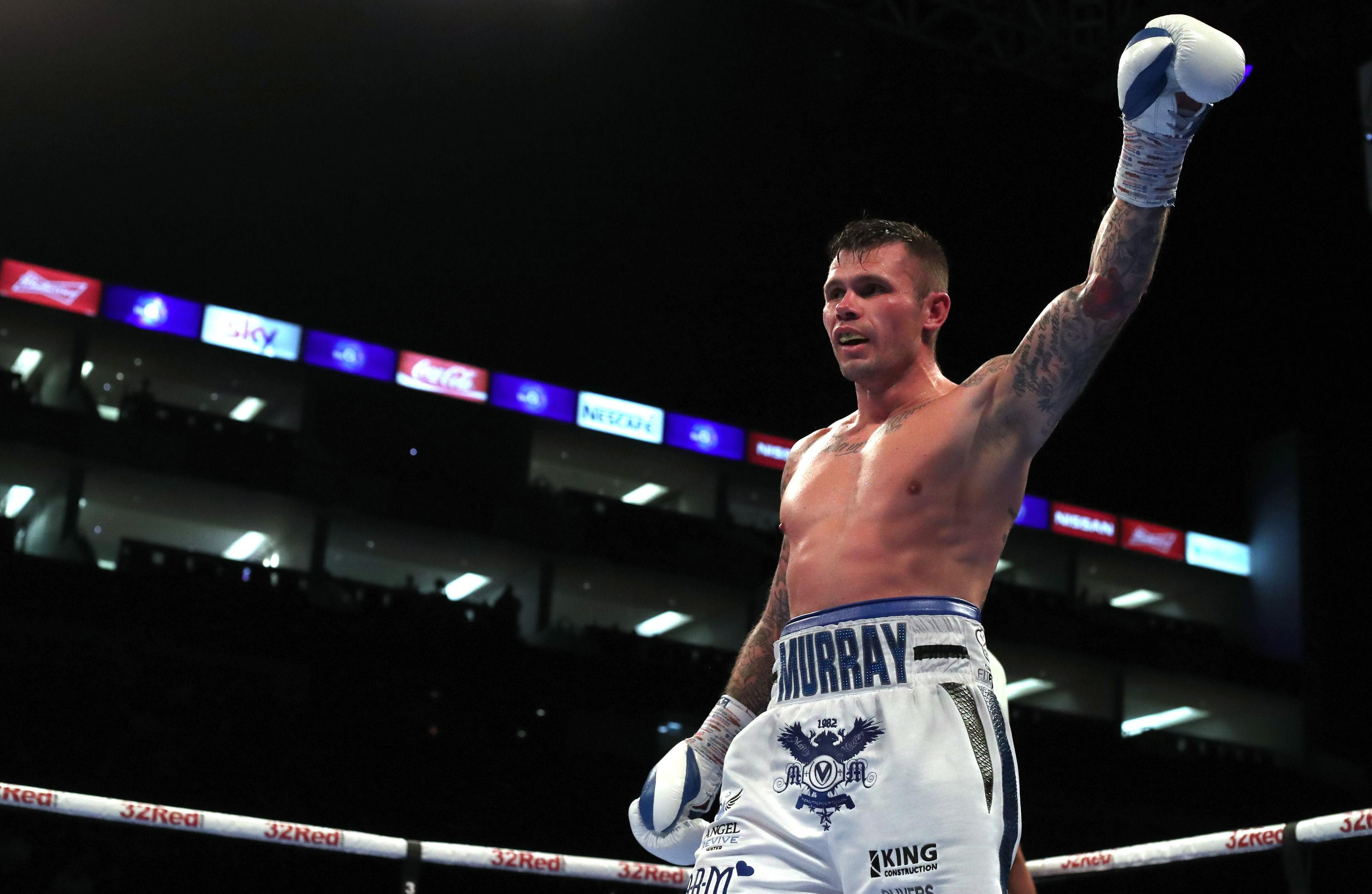 The St Helens scrapper raises his arm in victory at the end of the fight