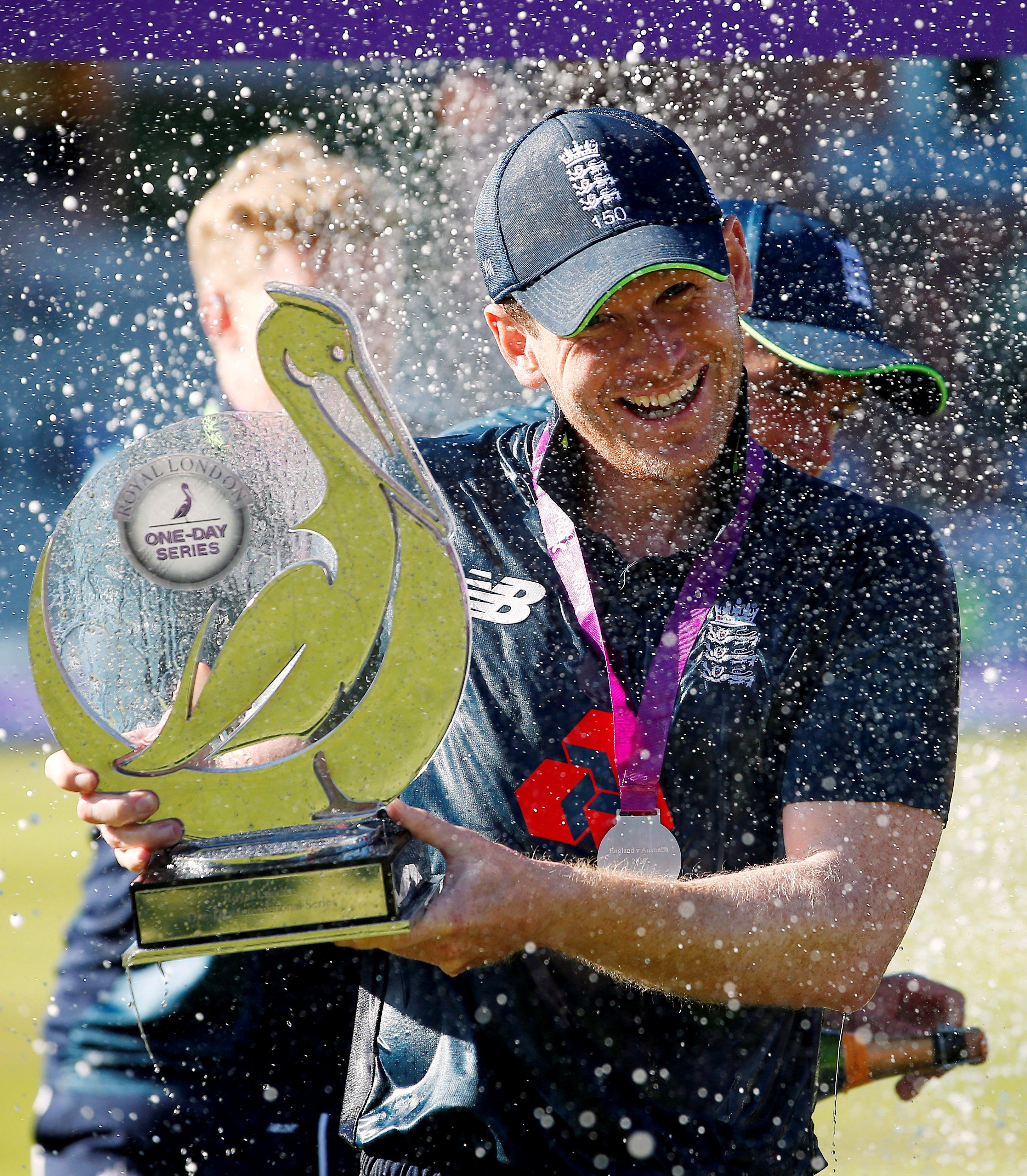 Captain Eoin Morgan lifts the trophy after England's whitewash over Australia
