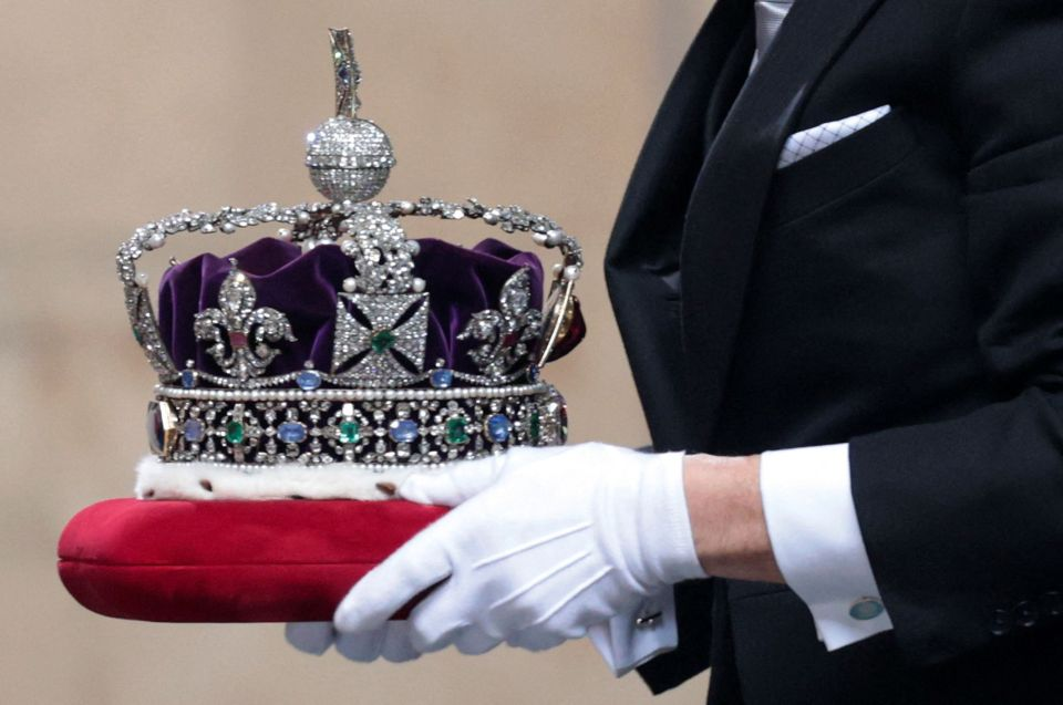 The Queen's diamond-encrusted Imperial State Crown is so heavy that she can't look down in speeches