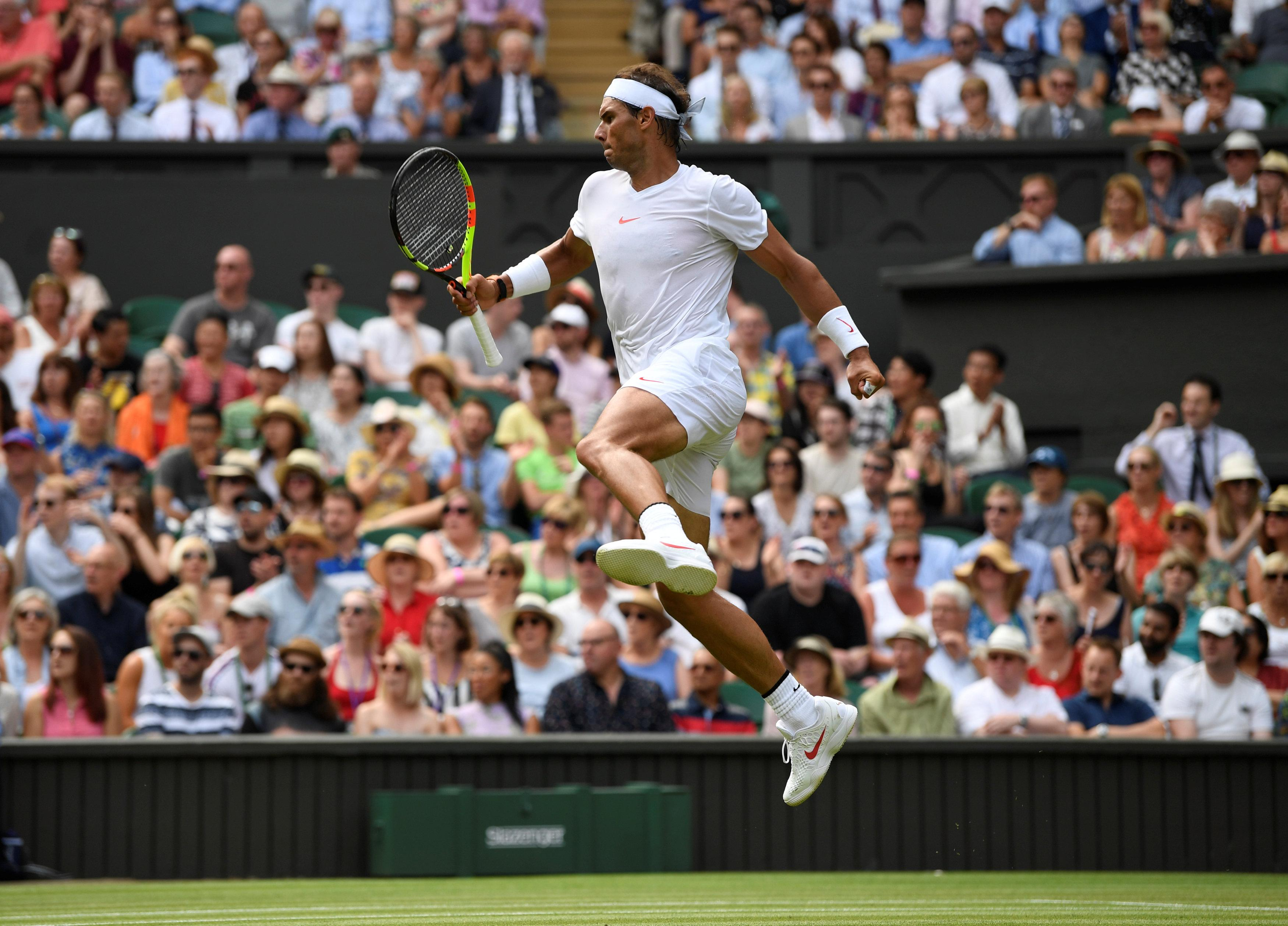 Nadal leaps in celebration as he seals victory to keep on course for his third Wimbledon title