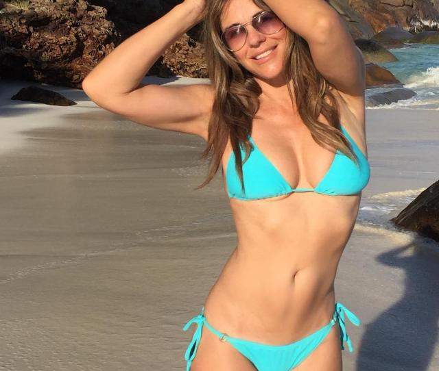 Elizabeth Hurley  Shows Off Her Toned Physique As She Poses On