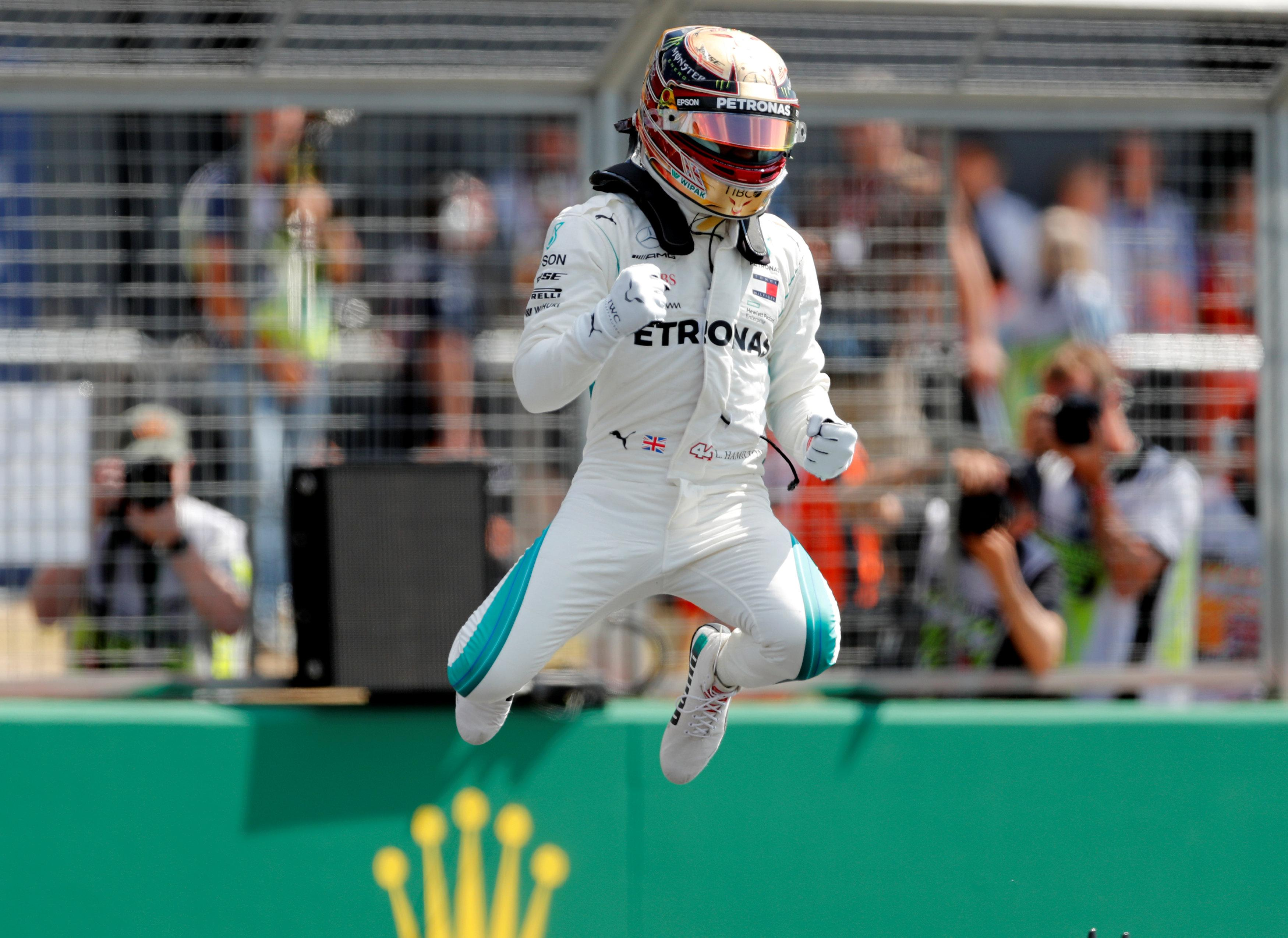 Lewis Hamilton shows his delight at taking pole at Silverstone