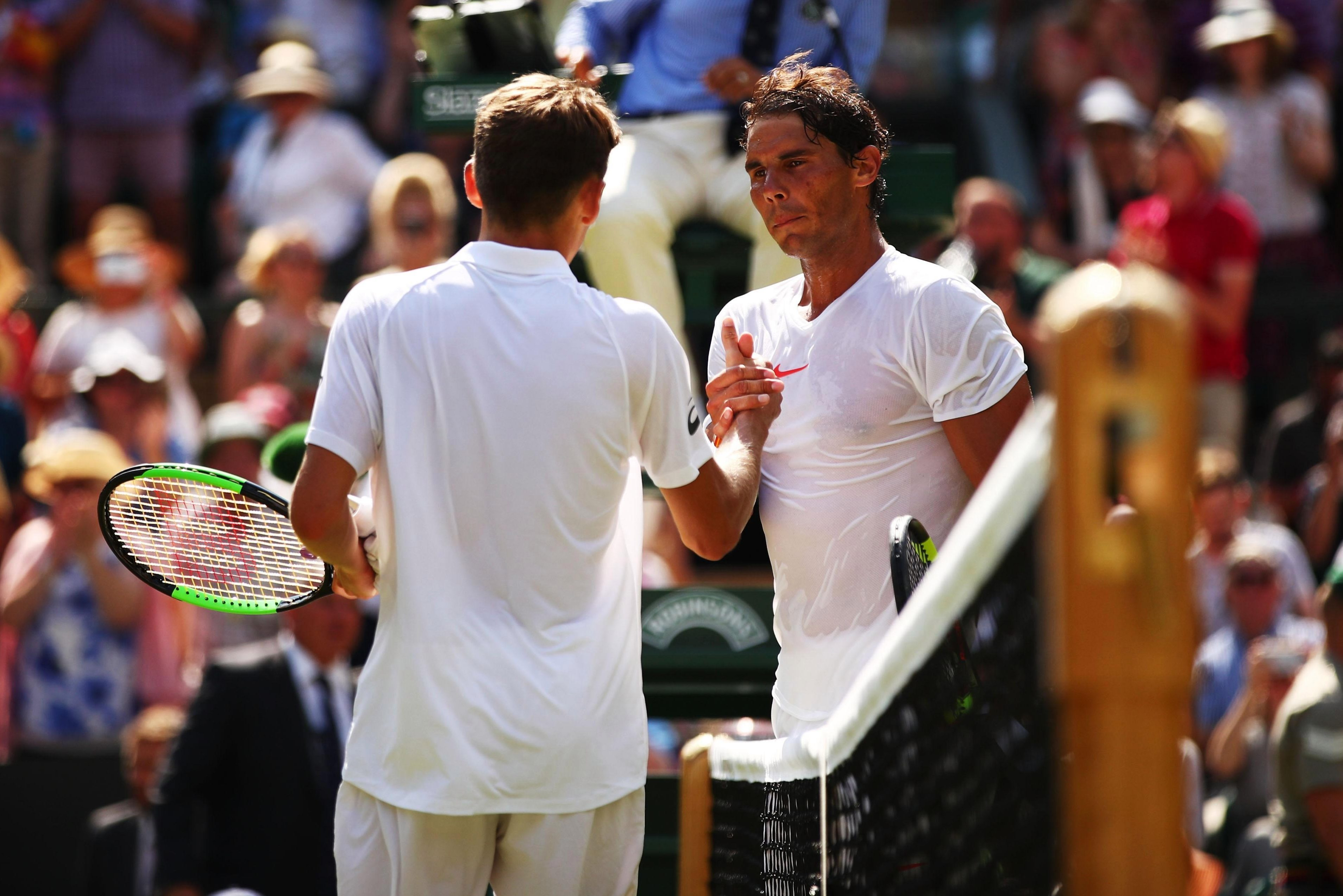 Rafael Nadal shakes hands with Alex De Minaur during their Men's Singles third round match on day six at Wimbledon.