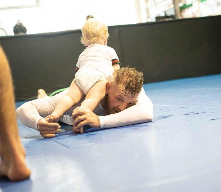 Conor McGregor grapples with his nappy-wearing one-year-old son Conor Jr