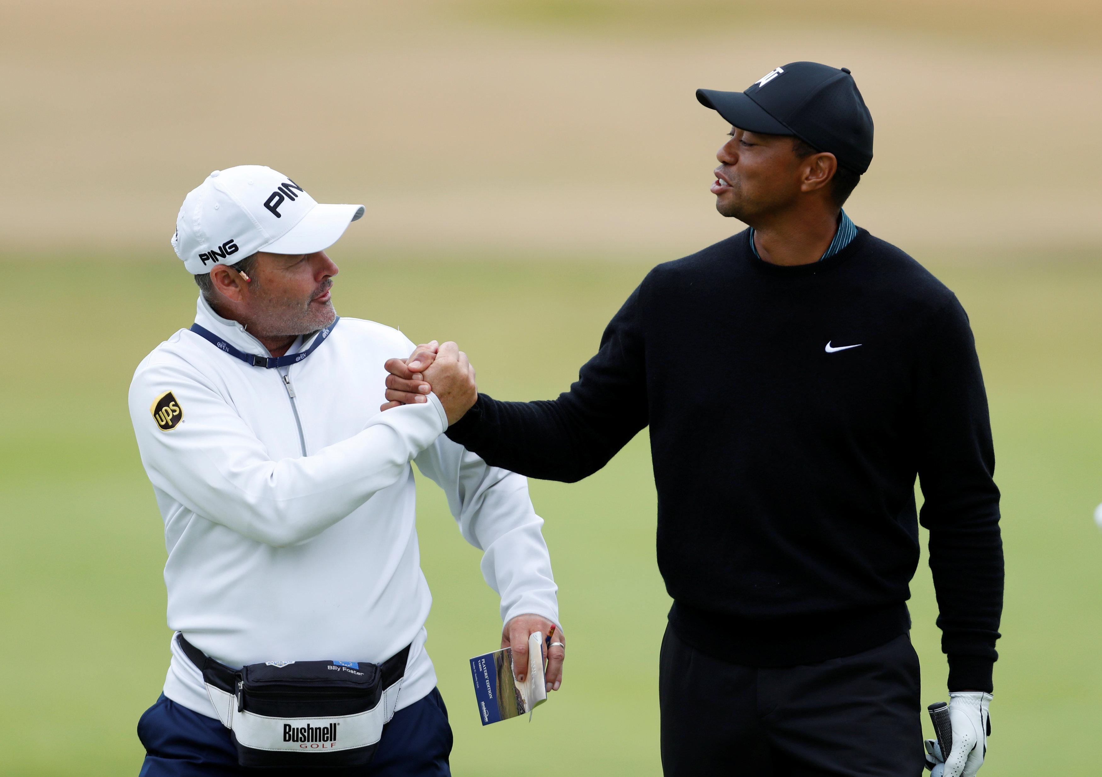 Woods was in good spirits with caddie Billy Foster in the practice rounds on Monday