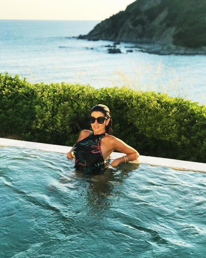 Fellow Liverpool star Firminos wife convinced Natalia, pictured relaxing in a pool on holiday, she would settle on Merseyside