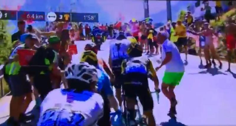 This was the moment a spectator ran forward towards Chris Froome