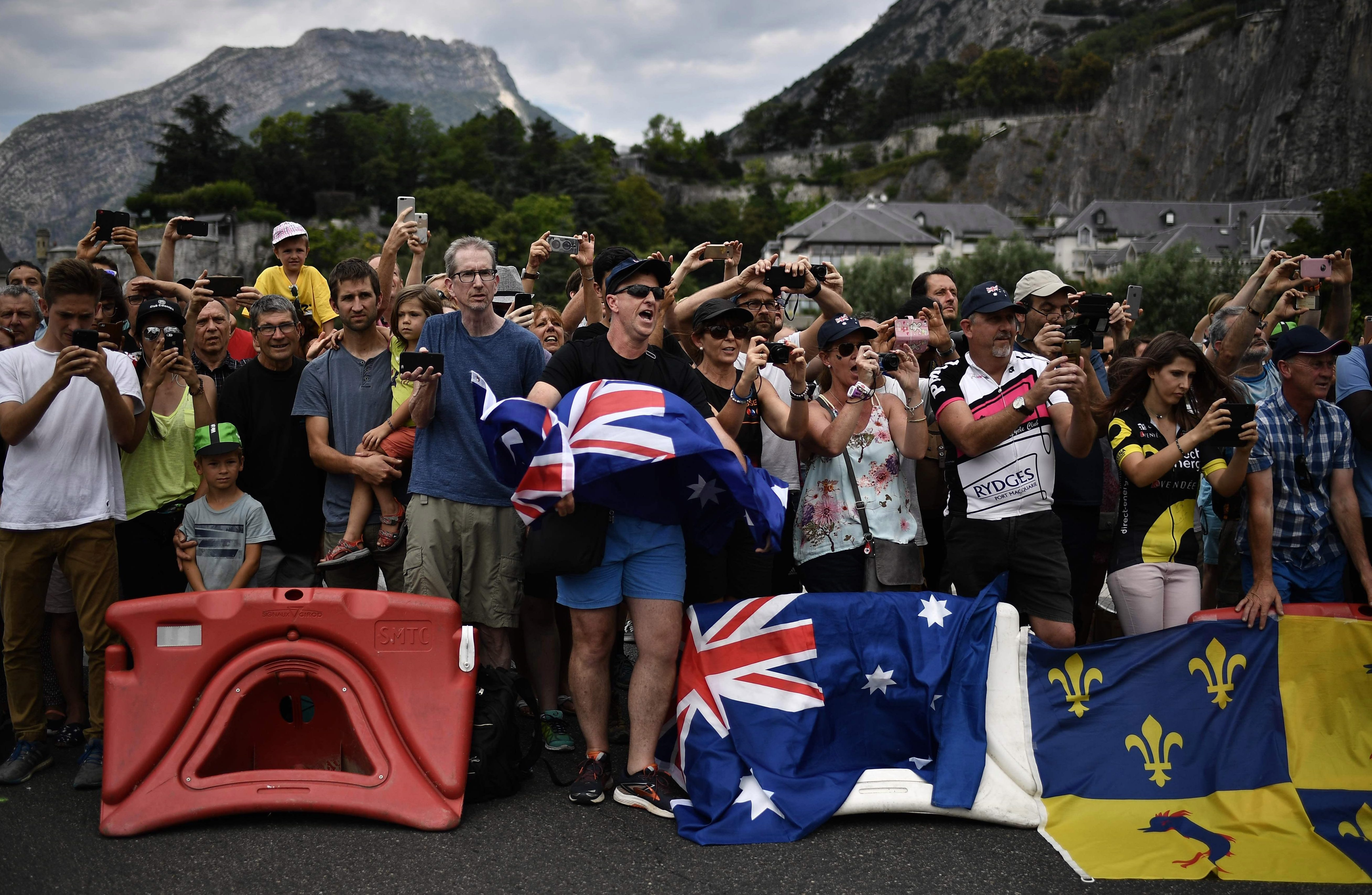 Fans wave Aussie flags on the 13th stage, from Le Bourg-d'Oisans to Valence