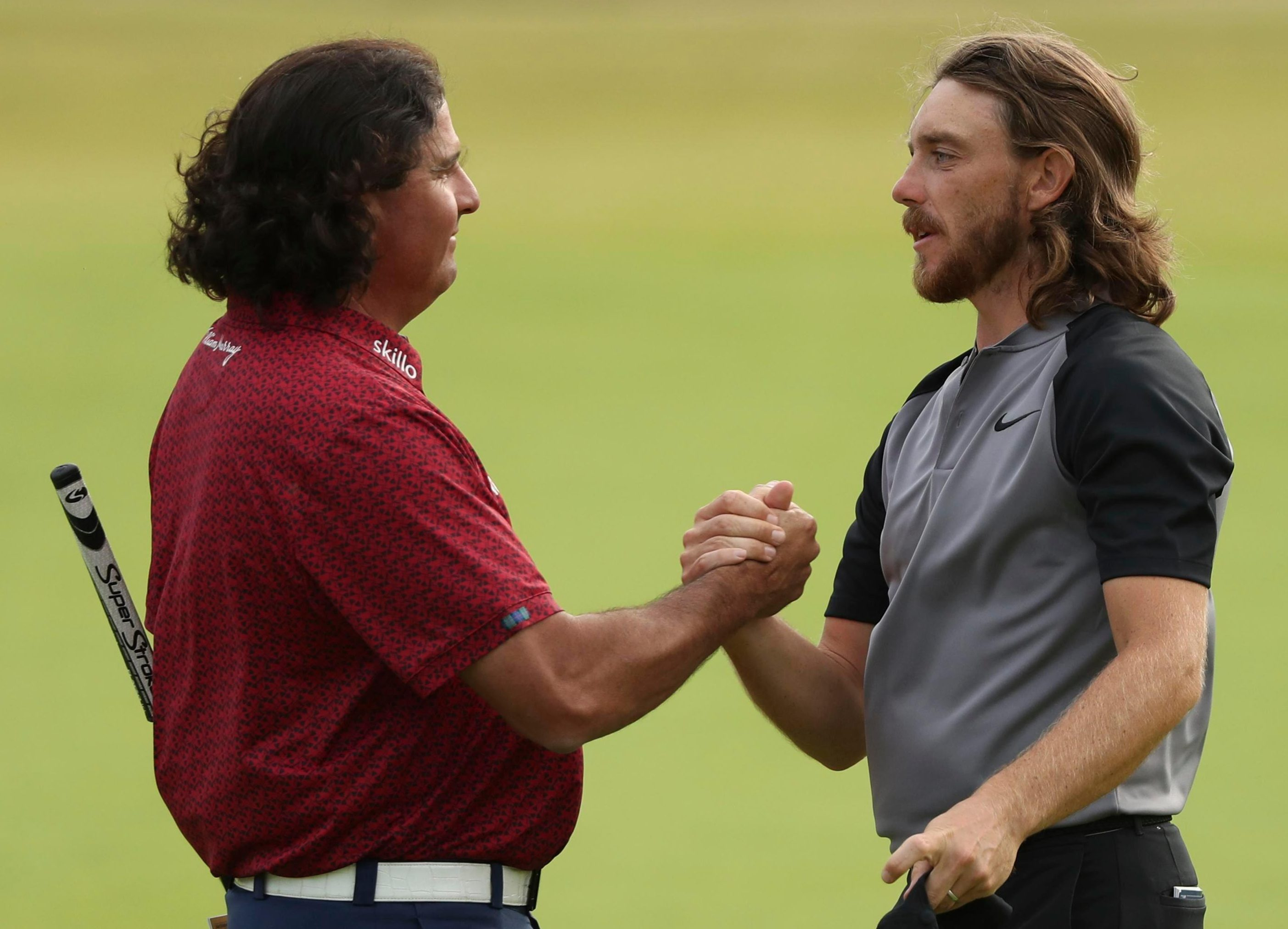 Tommy Fleetwood and Pat Perez shake hands after they lost their cutting edge