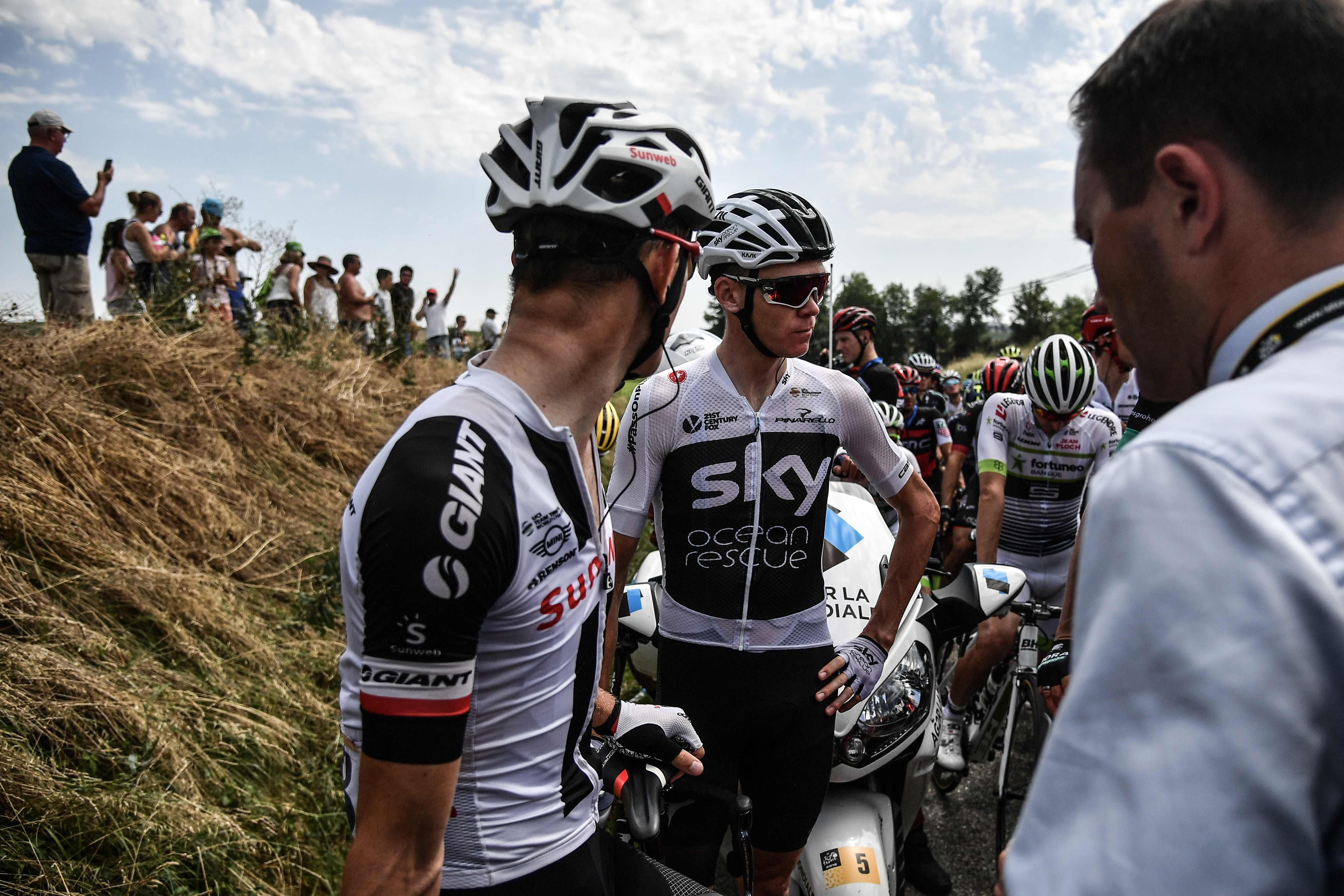 Chris Froome stood by the road chatting to rivals after the race was neutralised for around 15 minutes