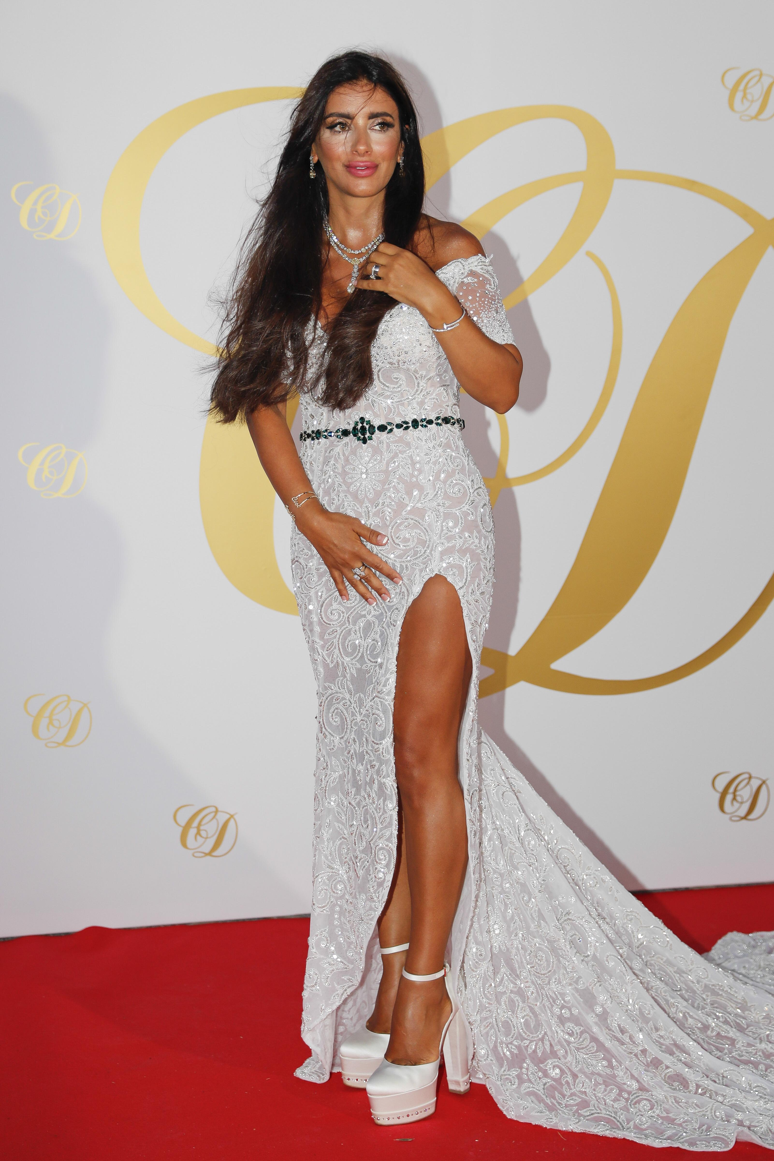 Daniella Semaan stuns on the red carpet in a long dress which shows off her leg