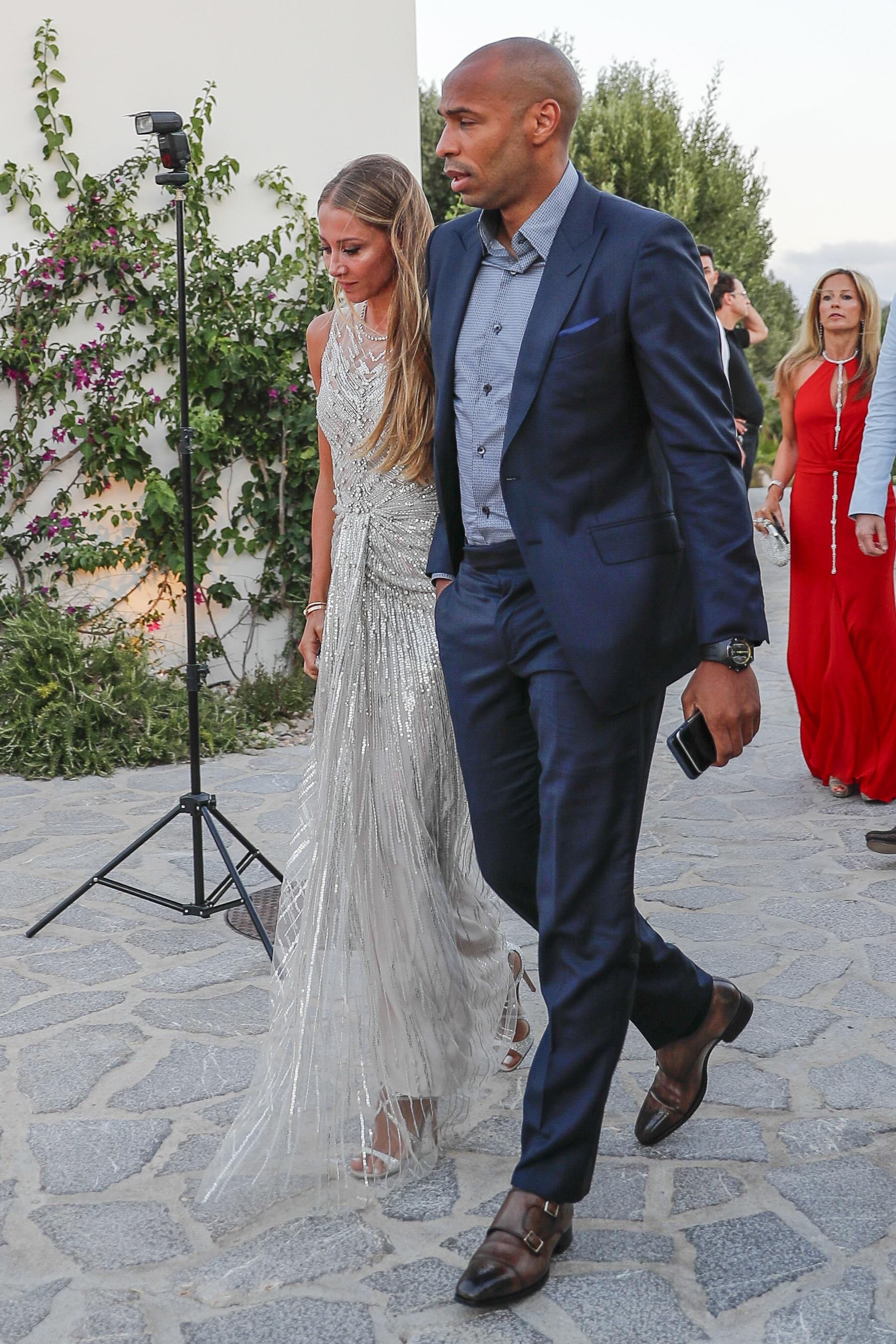 Thierry Henry and partner Andrea Rajacic arrive for Cesc Fabregas' party