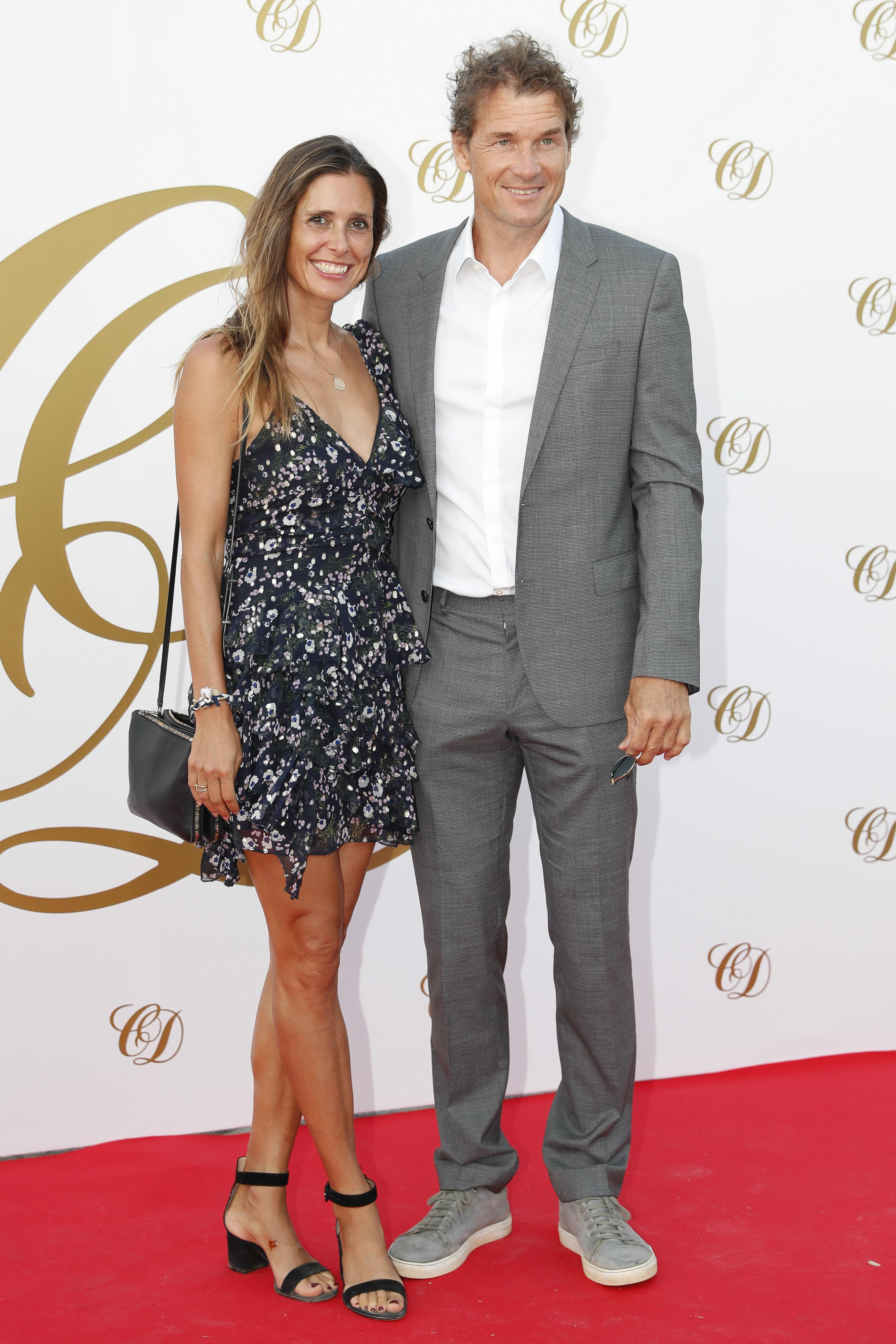 Former Arsenal keeper Jens Lehmann and wife Andrea turn out for Cesc Fabregas' wedding party