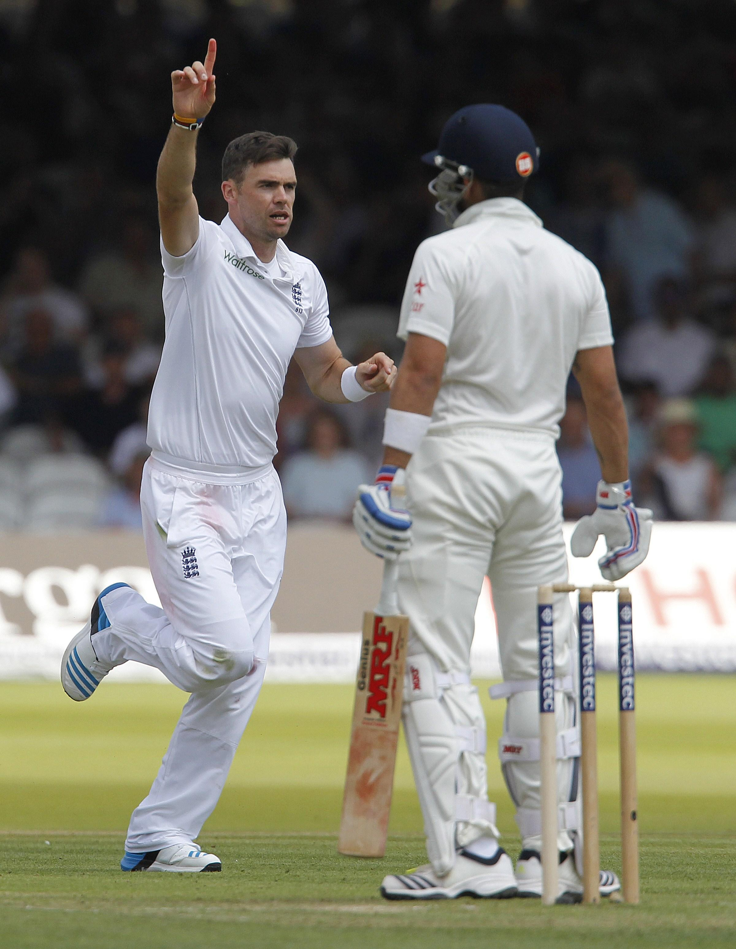 James Anderson celebrates taking the wicket of Virat Kohli four years ago