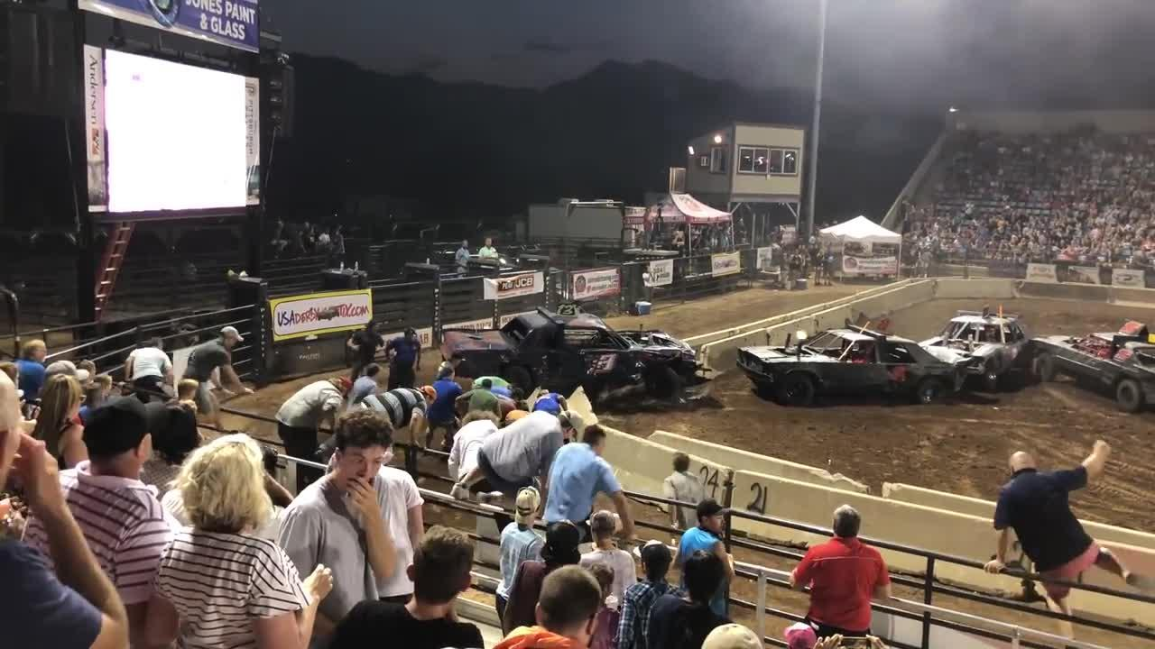 Hero spectators rush to help the trapped official