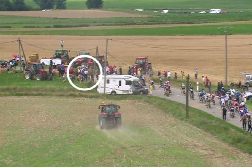 Tour broadcasters later highlighted exactly what happened as tractors pushed bales of hay into the road at the last second in protest at the Tour de France