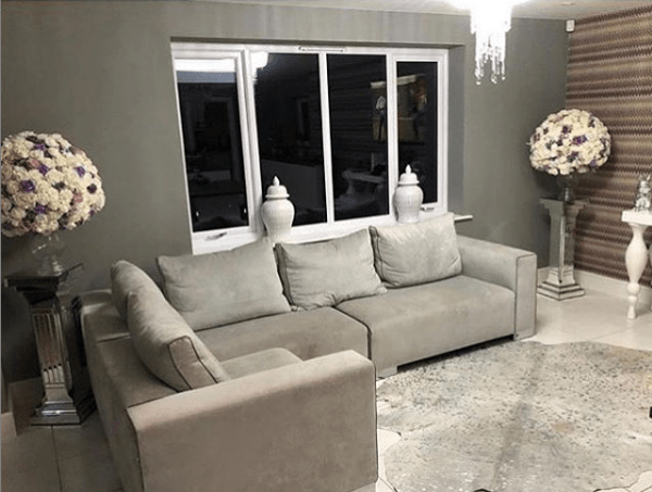 The light grey sofa is the perfect place to relax