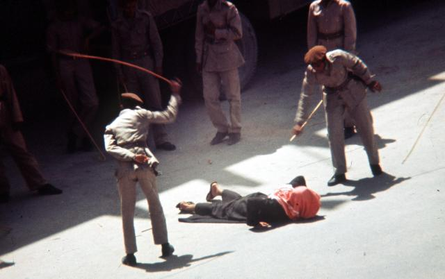 A man is brutally flogged by uniformed guards in Saudi Arabia