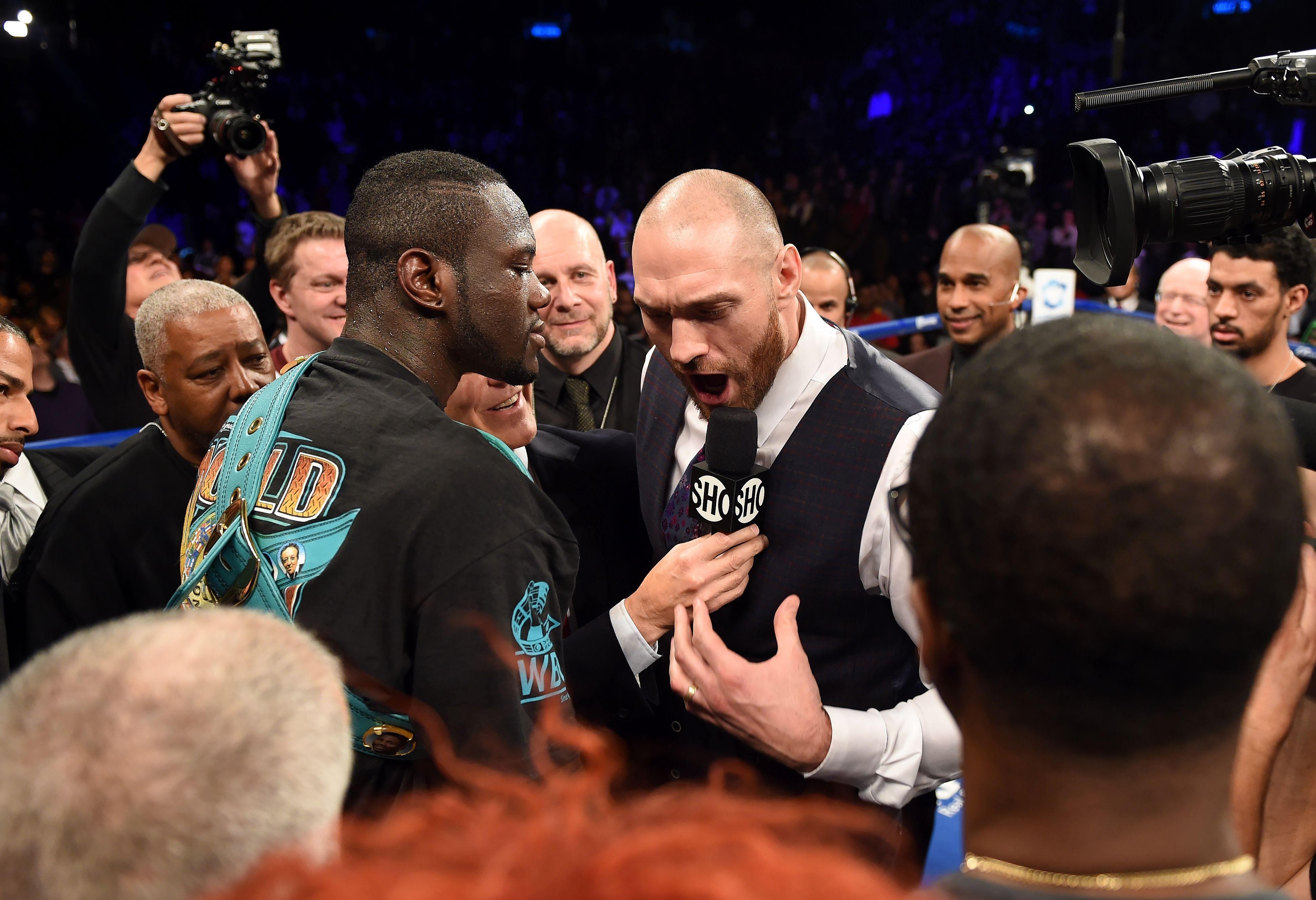 Tyson Fury, right, says he would fight Deontay Wilder, left, for free
