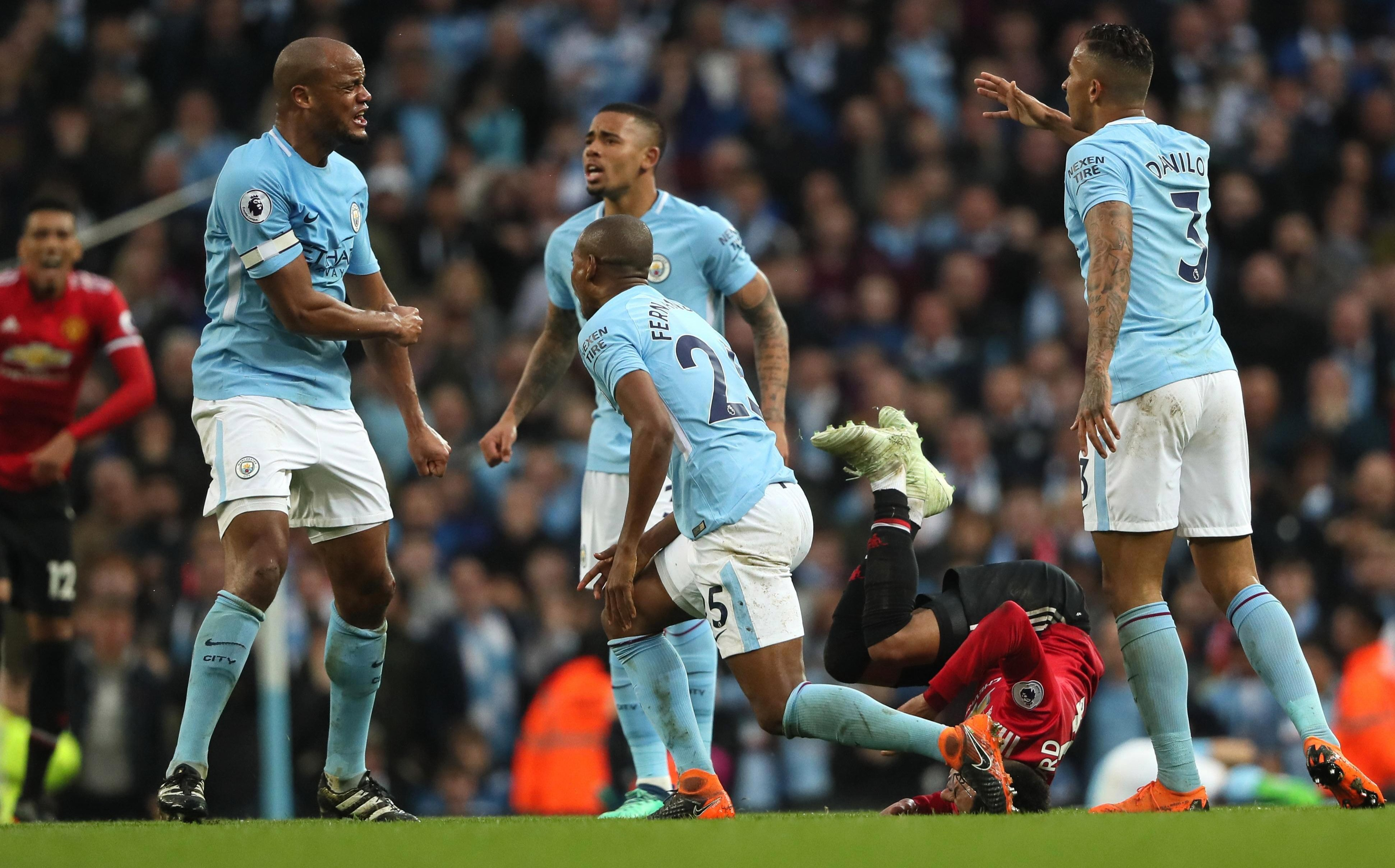 Manchester City's stars conduct an on-field inquest during their defeat to United in April