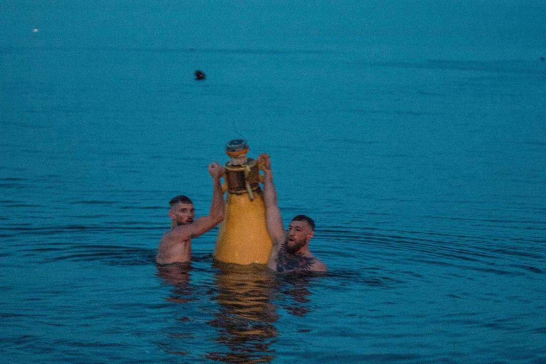 The aim of the swim was to reach the nearby buoy in the water